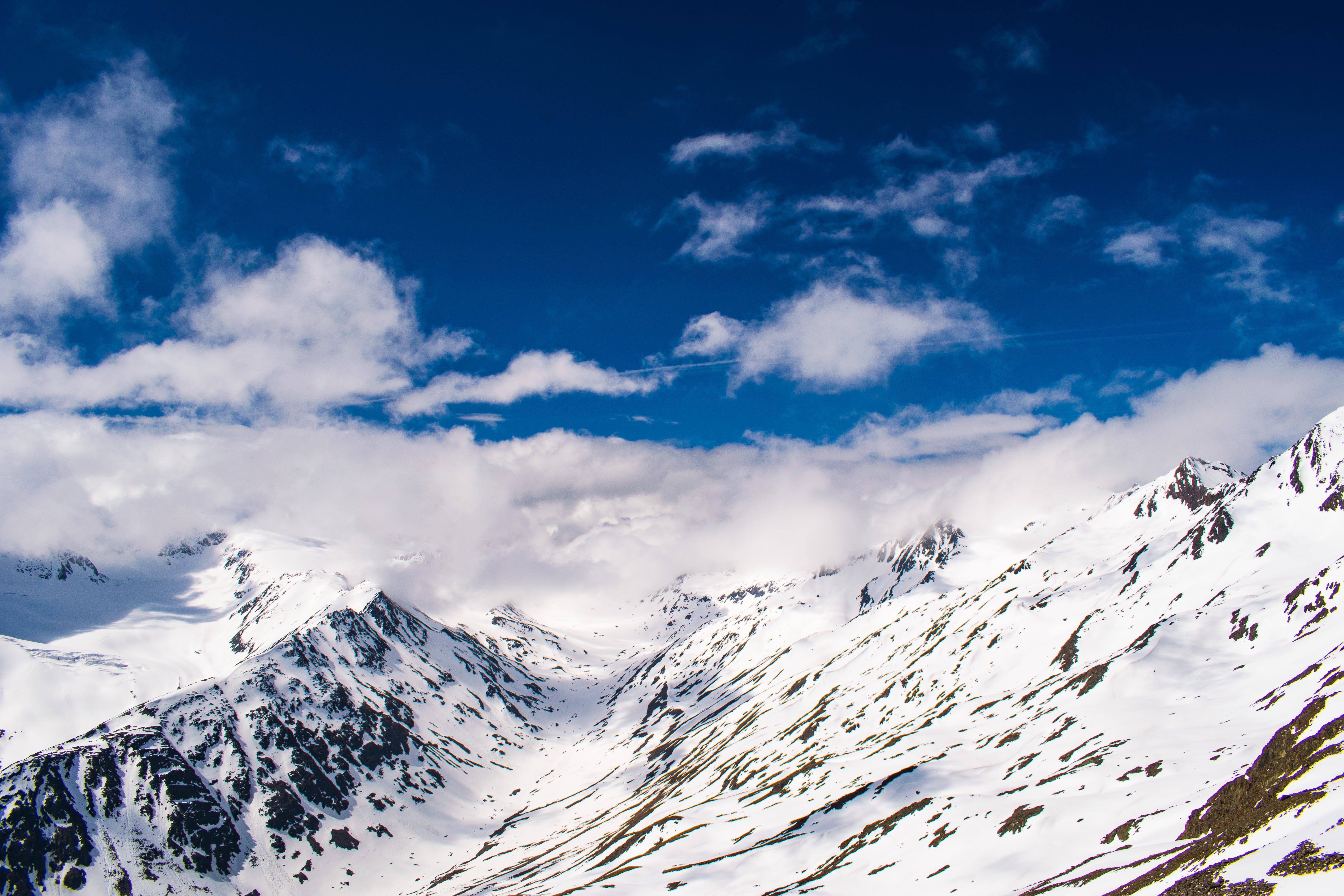 Snowy Mountain With White Clouds