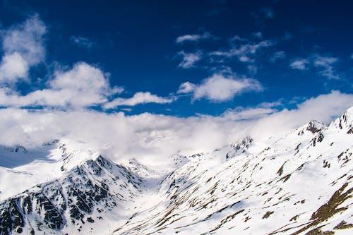 Kostnadsfri bild av bergen, blå himmel, dagsljus, frost