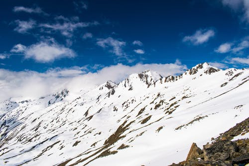 Безкоштовне стокове фото на тему «іній, блакитне небо, вершина гори, високий»