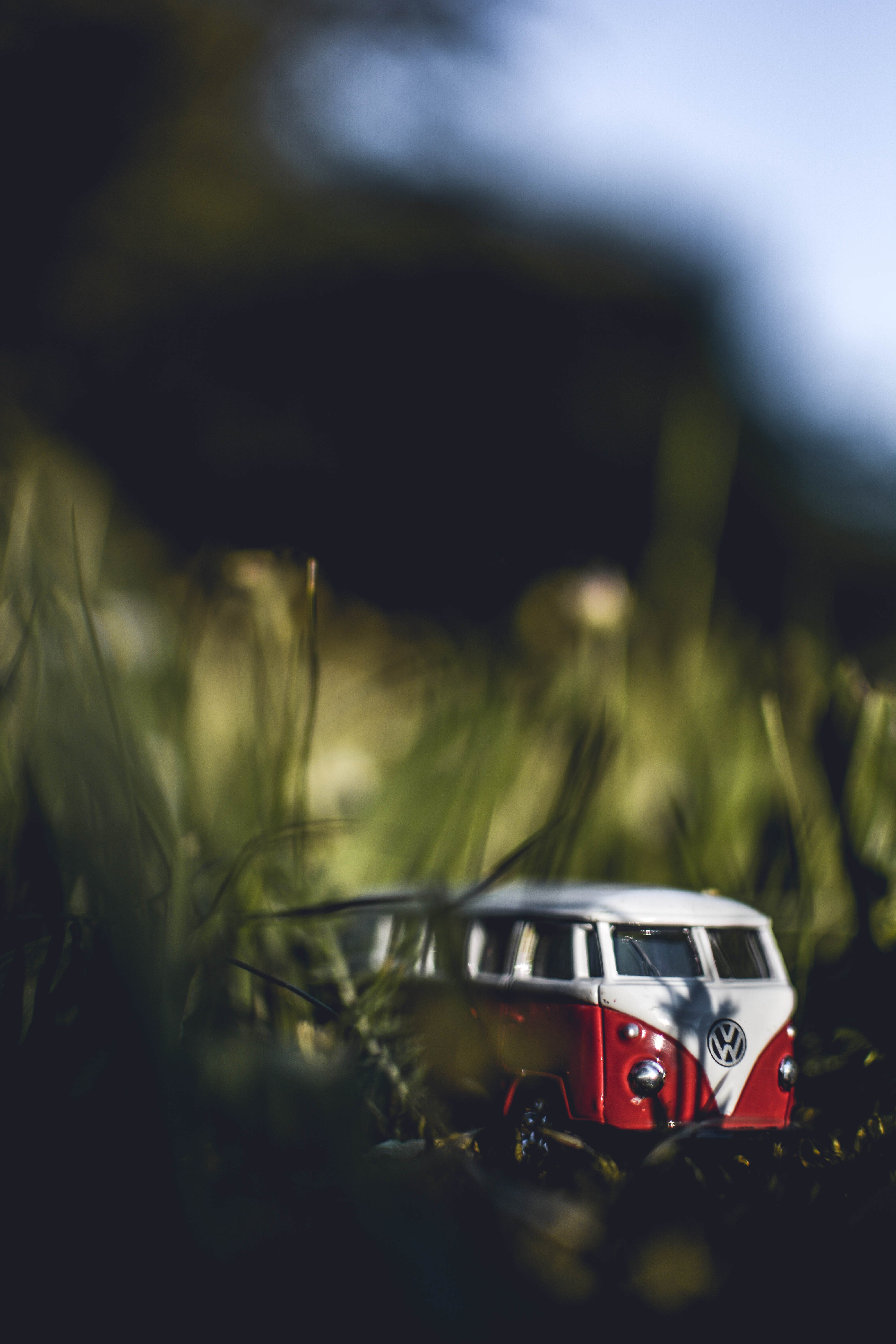 Shallow Focus Photography of White and Red Volkswagen Samba Die-cast Model