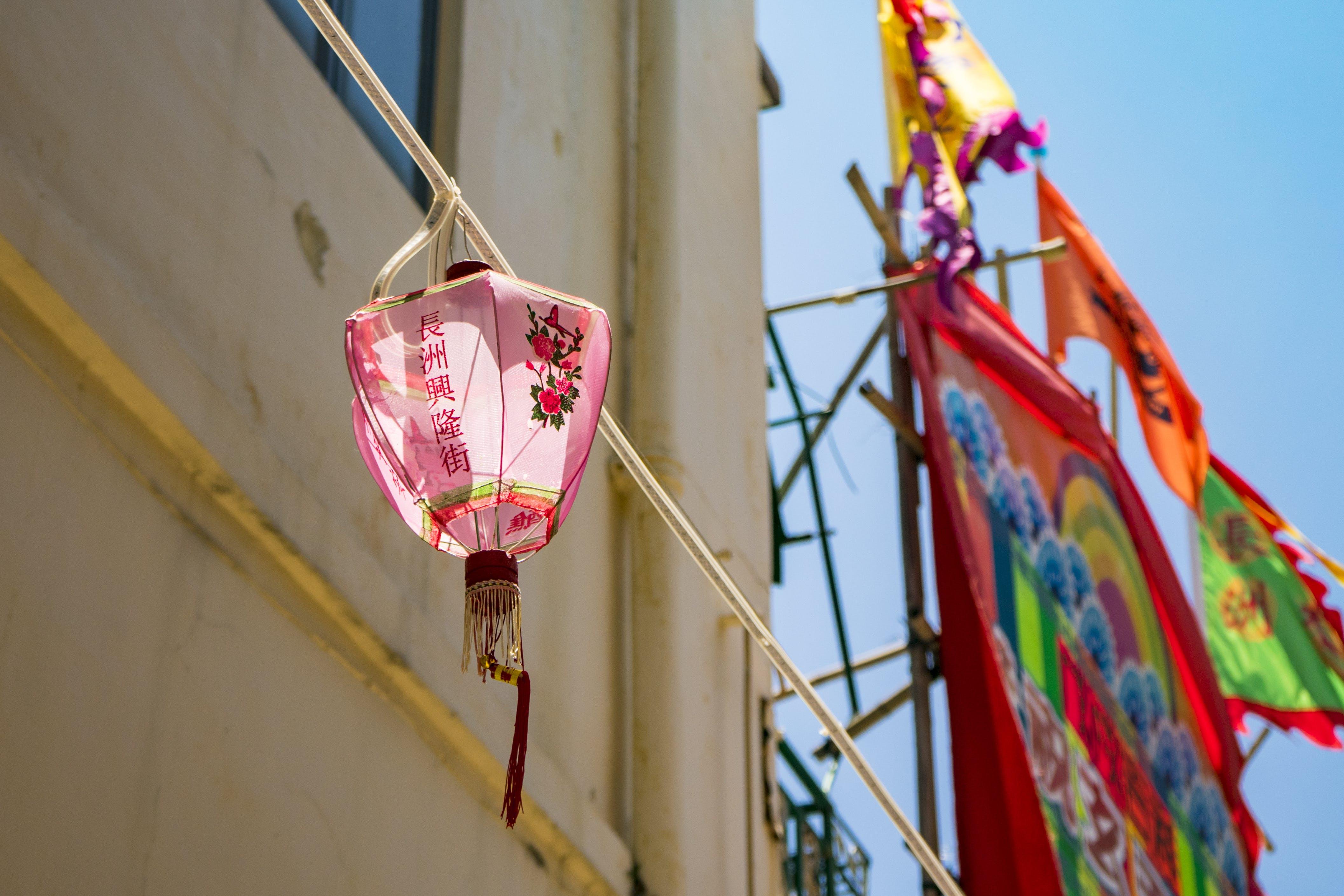 Low Angle Photo of Pink Lantern Decor