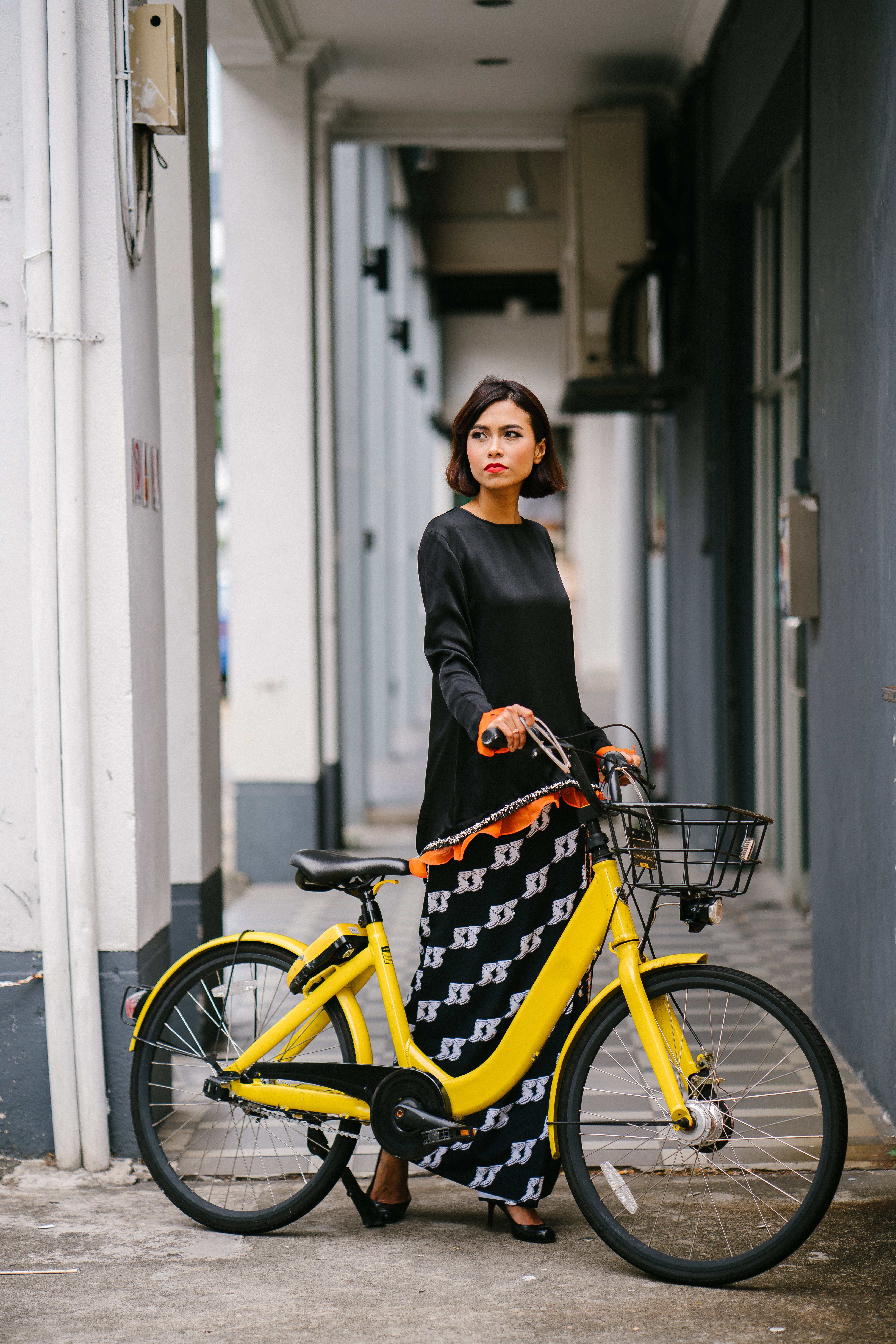 Woman Holding Yellow Bike at Daytime