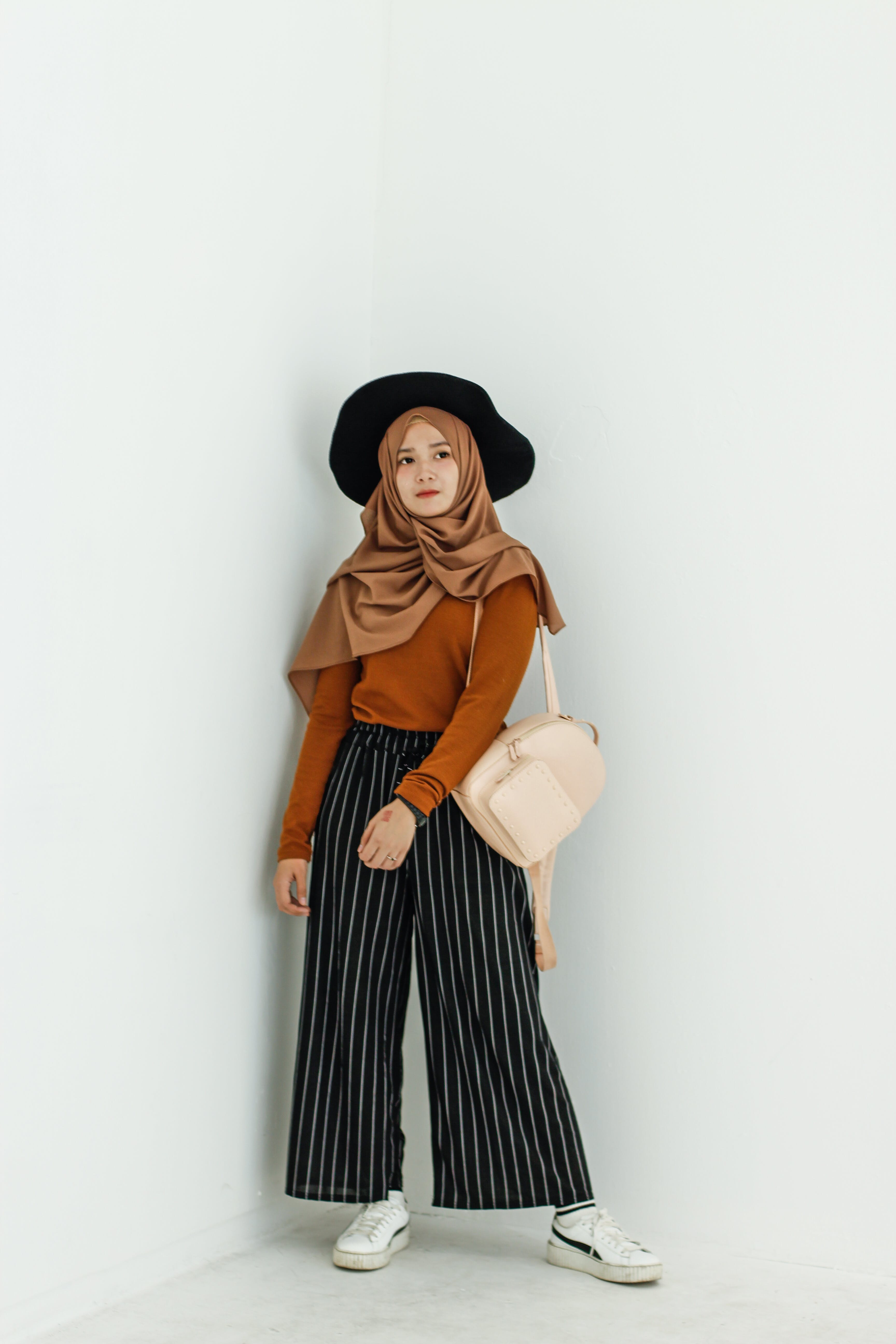 Woman in Brown Long-sleeved Shirt and Brown Hijab Headdress With Beige Leather Backpack
