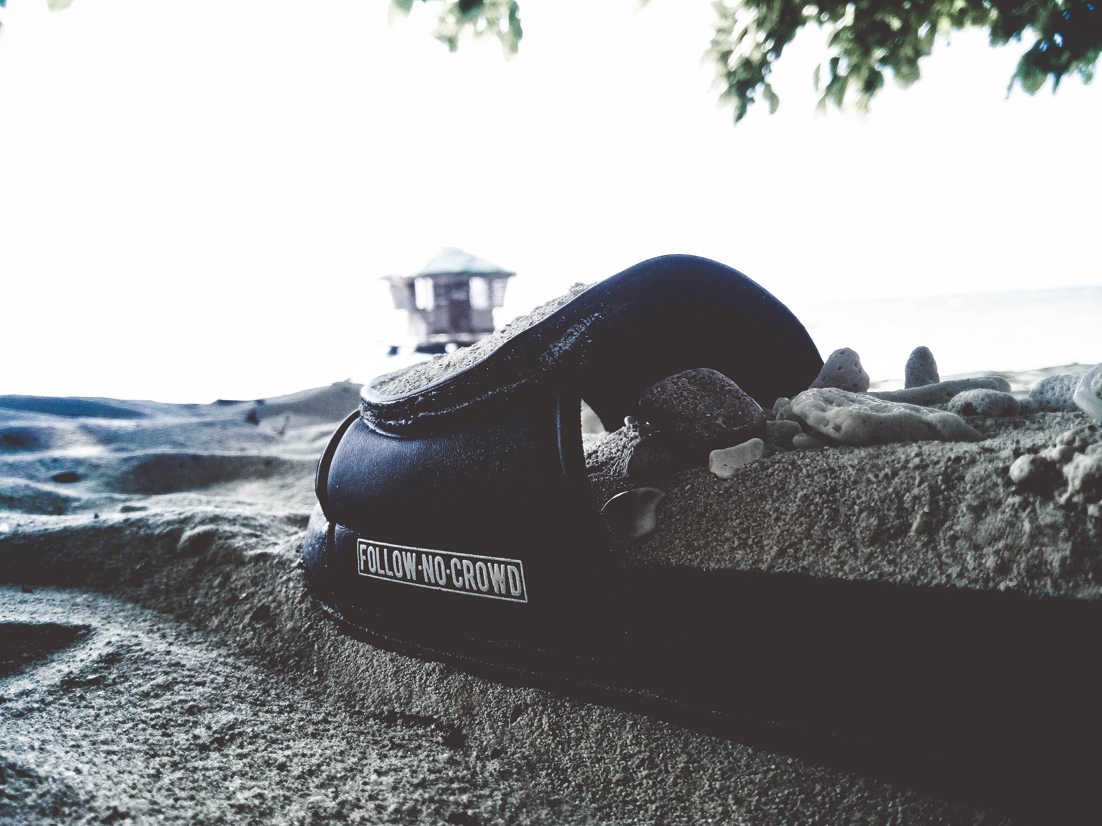 Black Textile on Gray Sand
