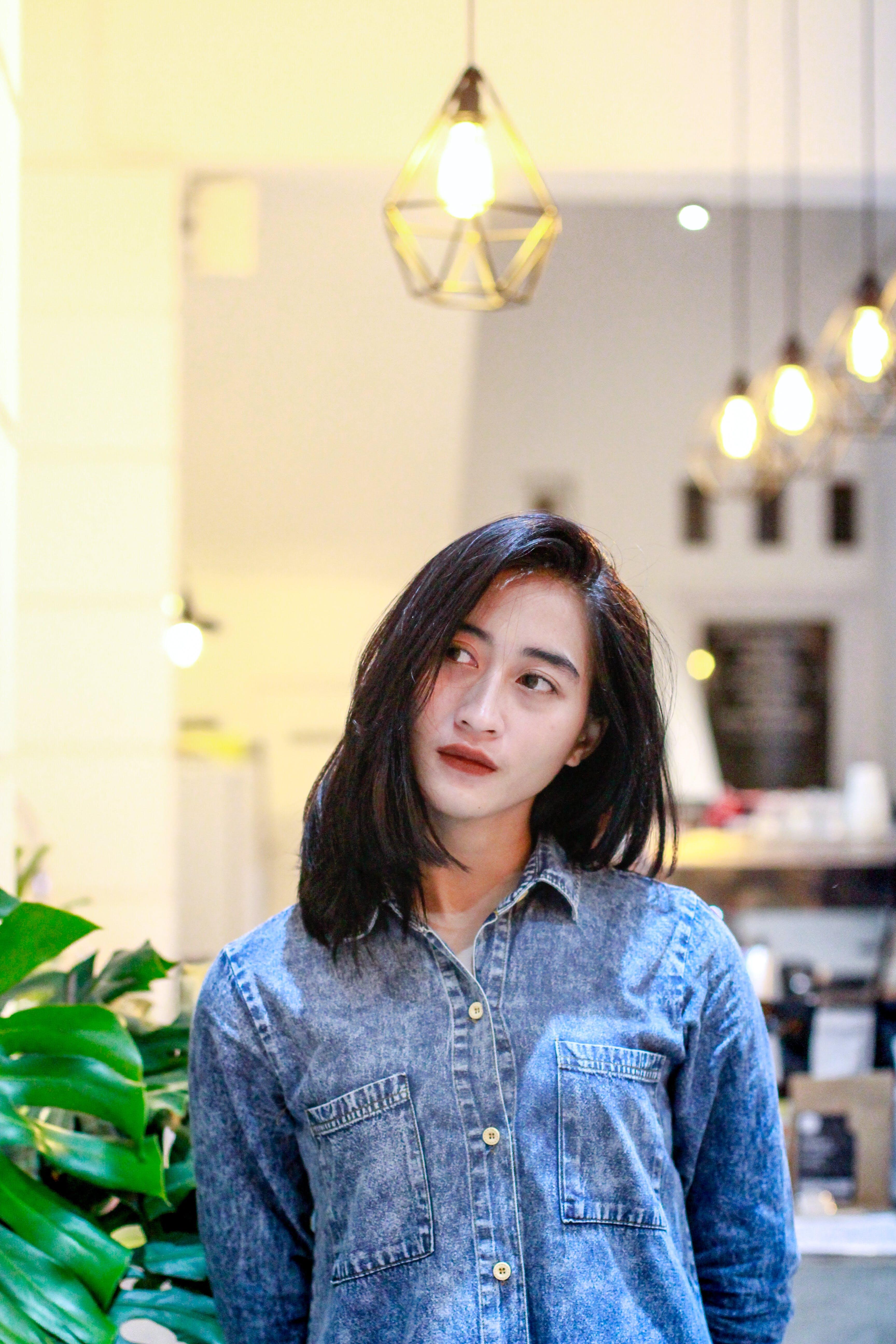 Woman in Blue Denim Button-up Jacket