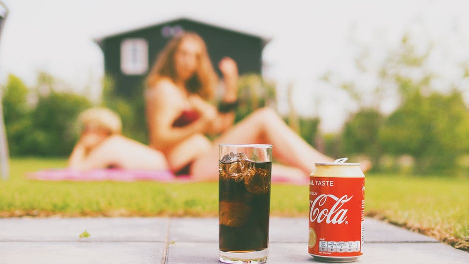 Coca-cola Can and Drinking Glass Filled With Coke