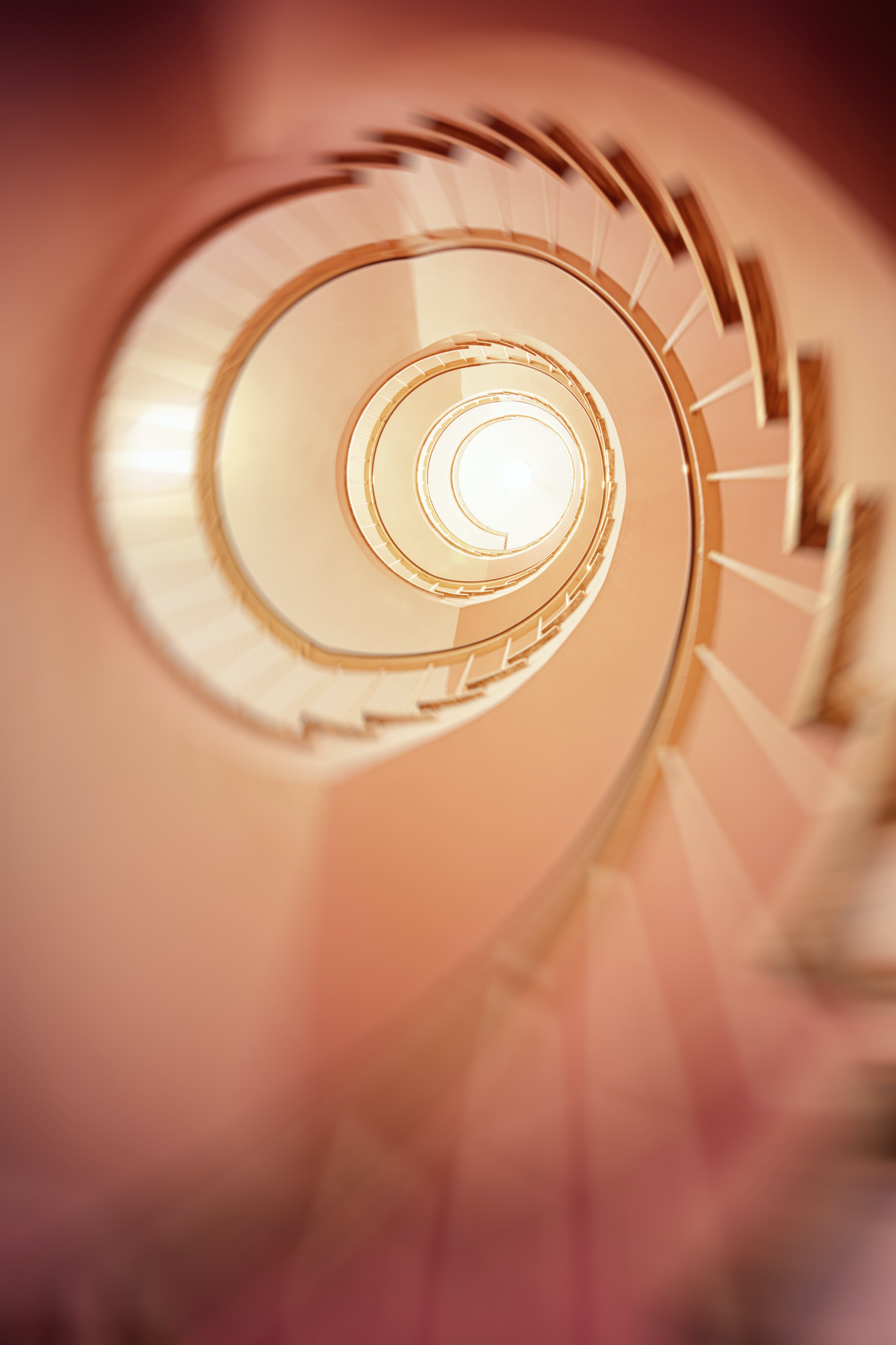 Low Angle Photography of Spiral Stair