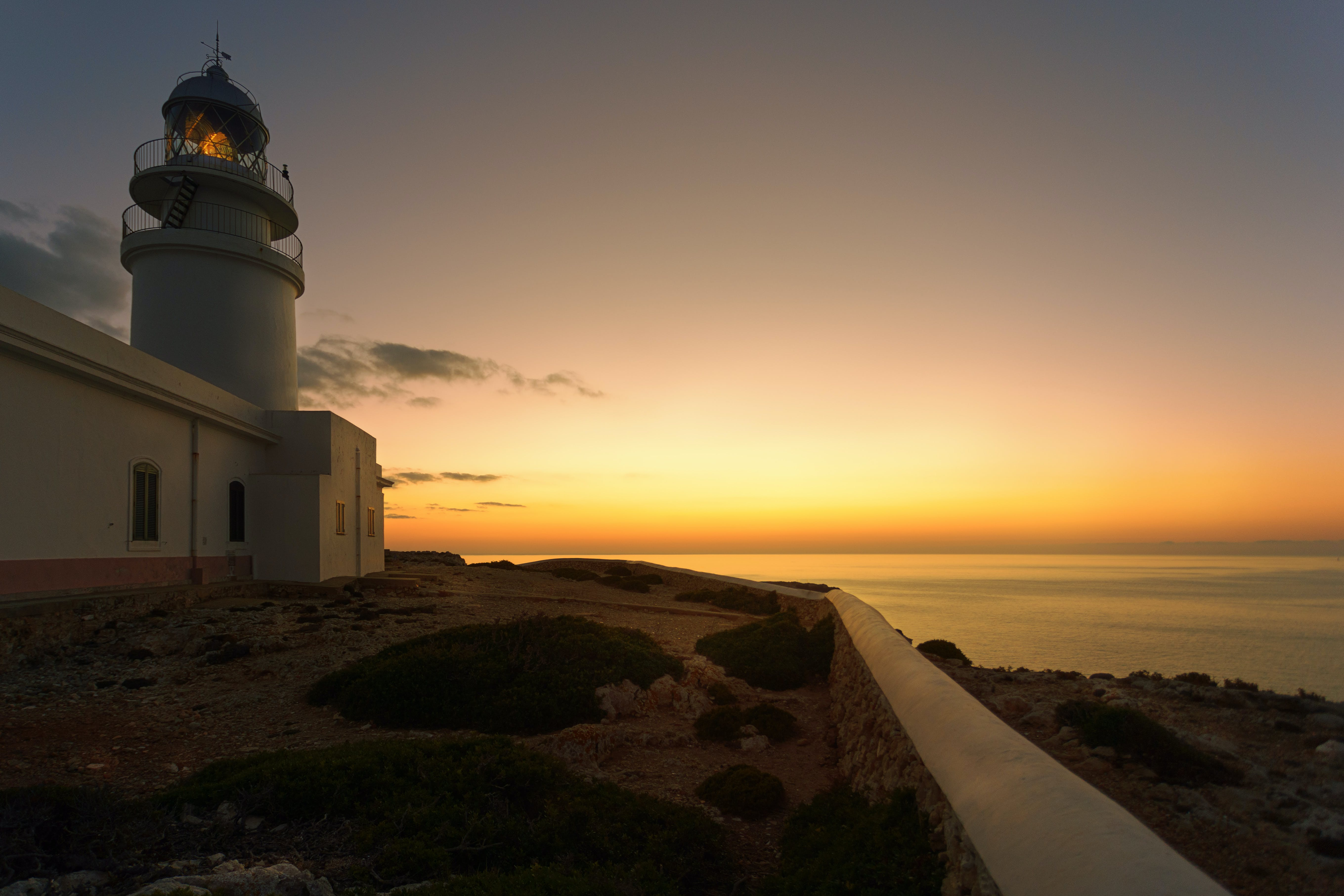 White Concrete Lighthouse during Golden Hour
