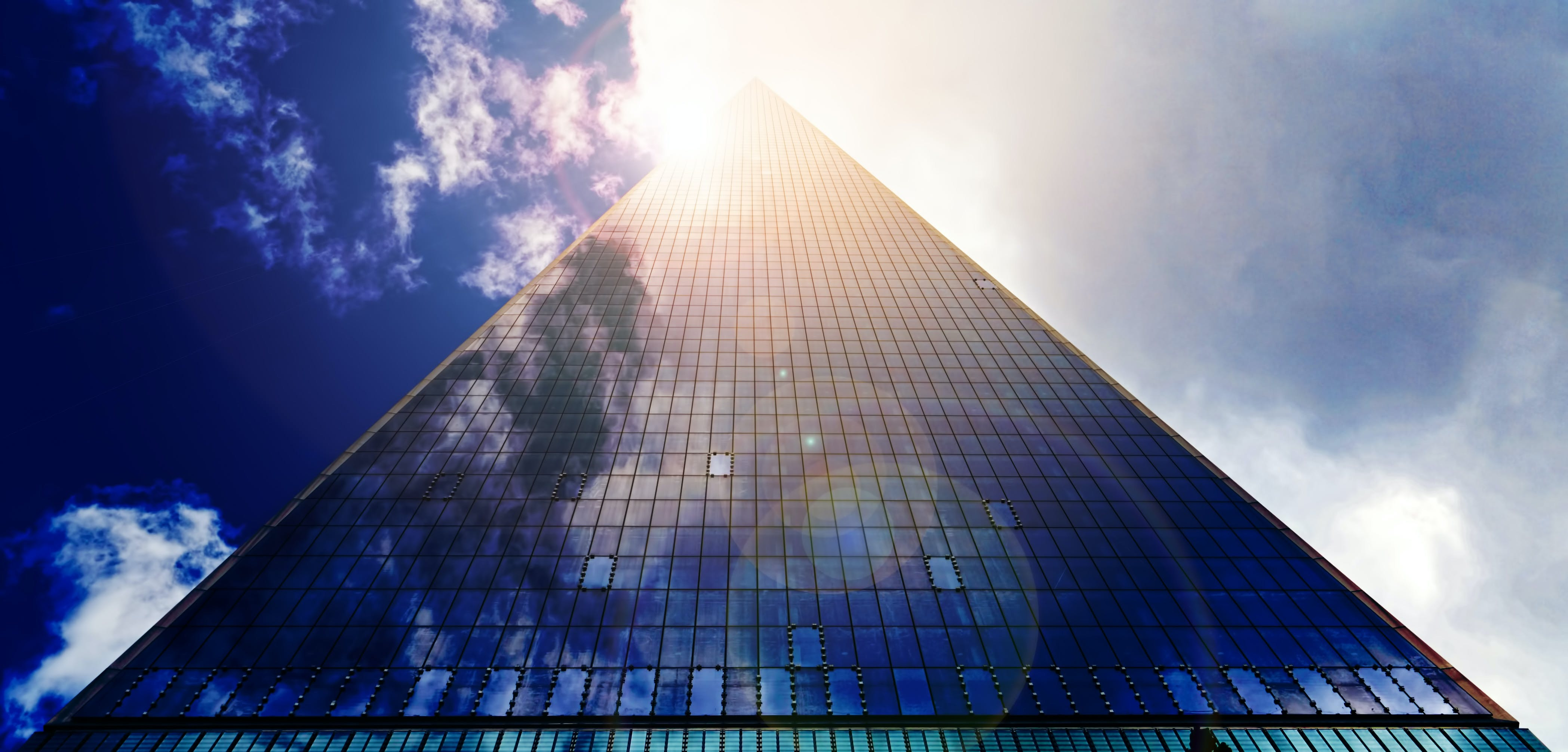 Low Angle Photograph of Pyramid Glass during Calm Weather