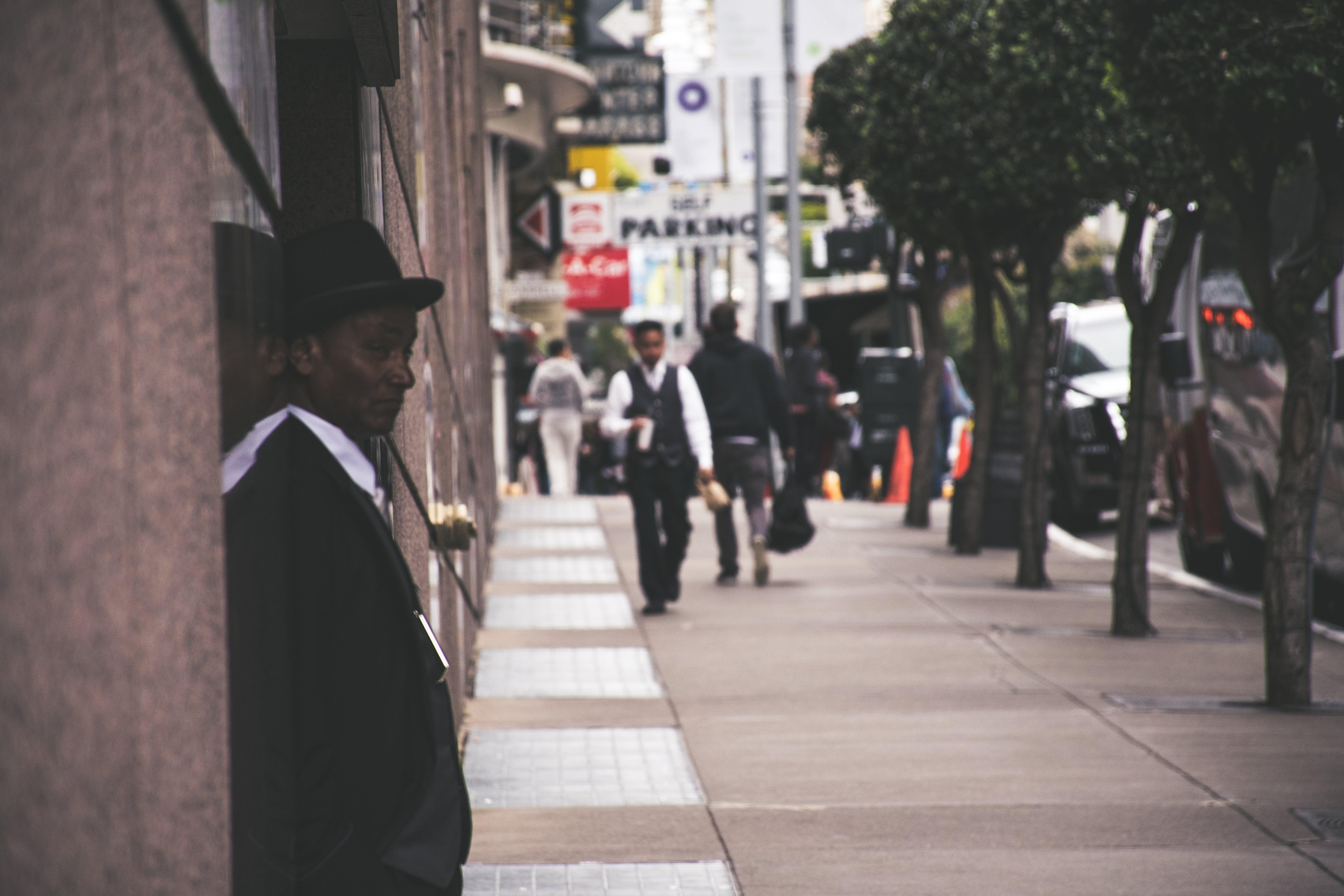 Man Wearing Black Blazer Beside Building