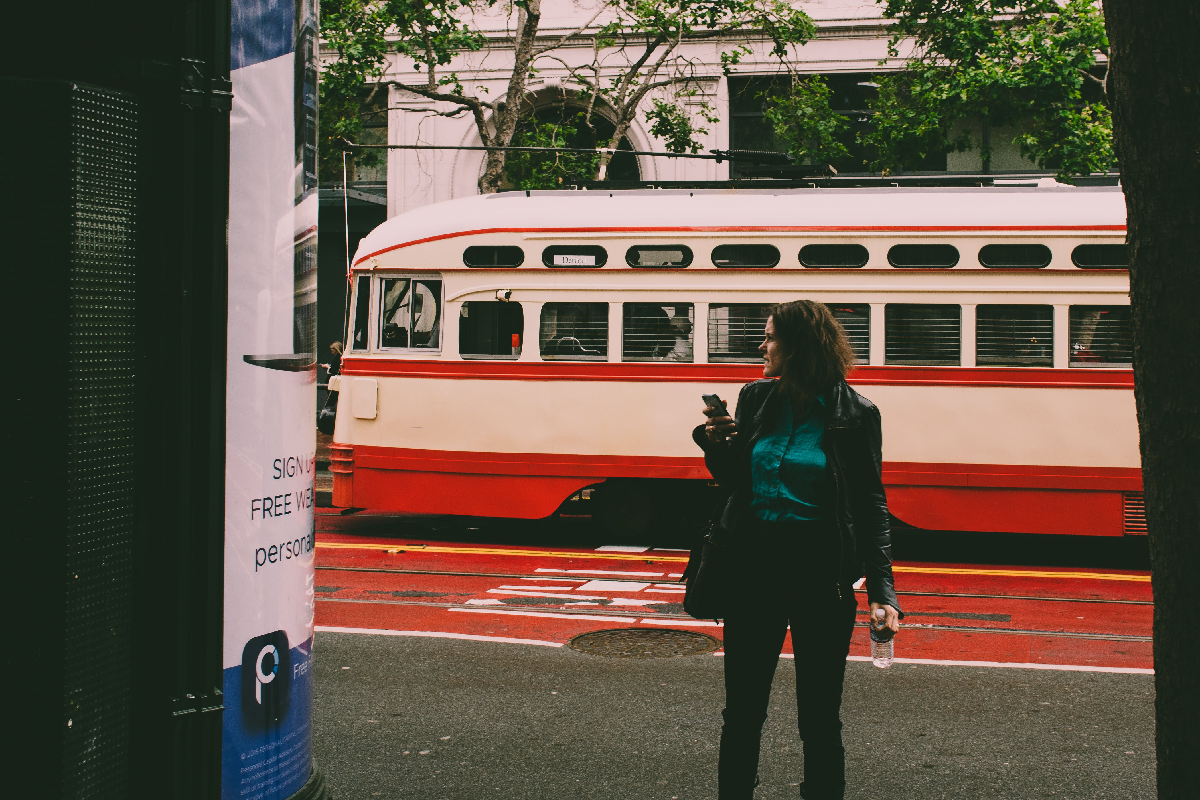 Woman Wearing Black Blazer Beside White and Red Cable Cab