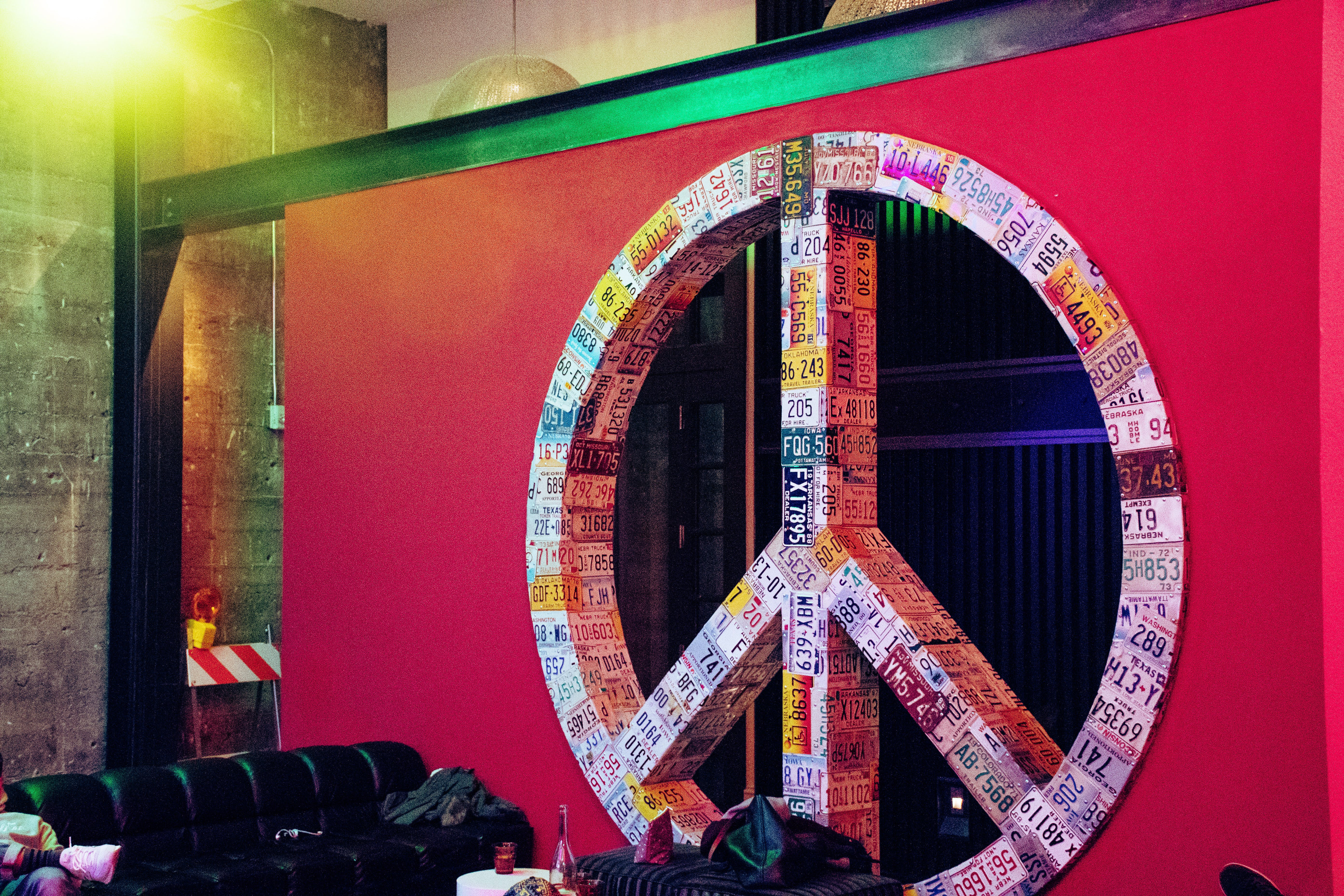 Red and Multicolored License Plate Covered Peace Sign Wall Decor
