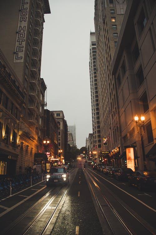 Gray Concrete Buildings Beside Road