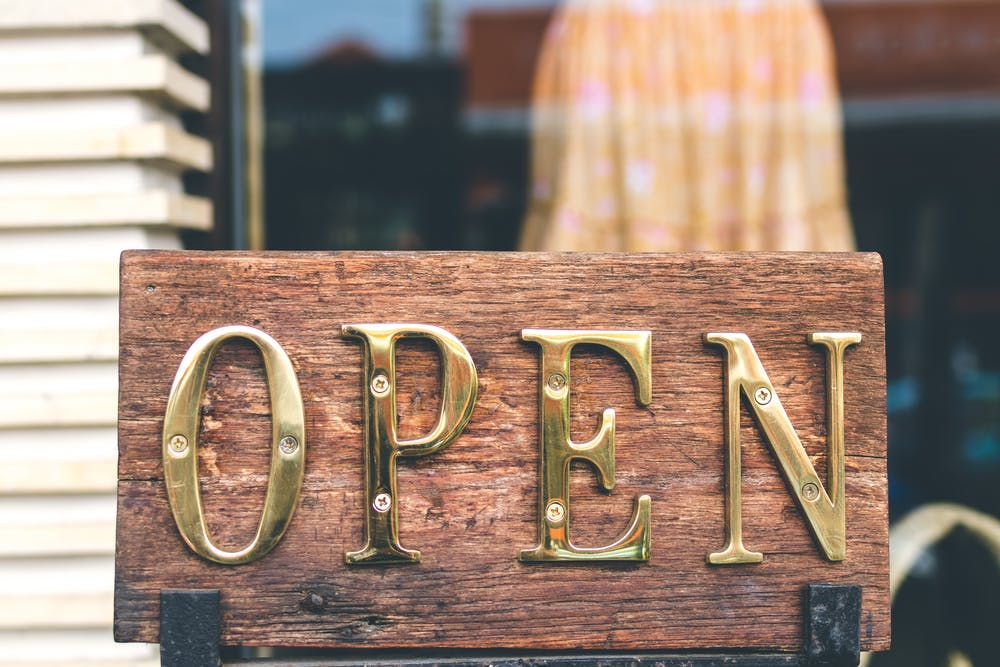 A gold open-printed decorative signage. | Photo: Pexels