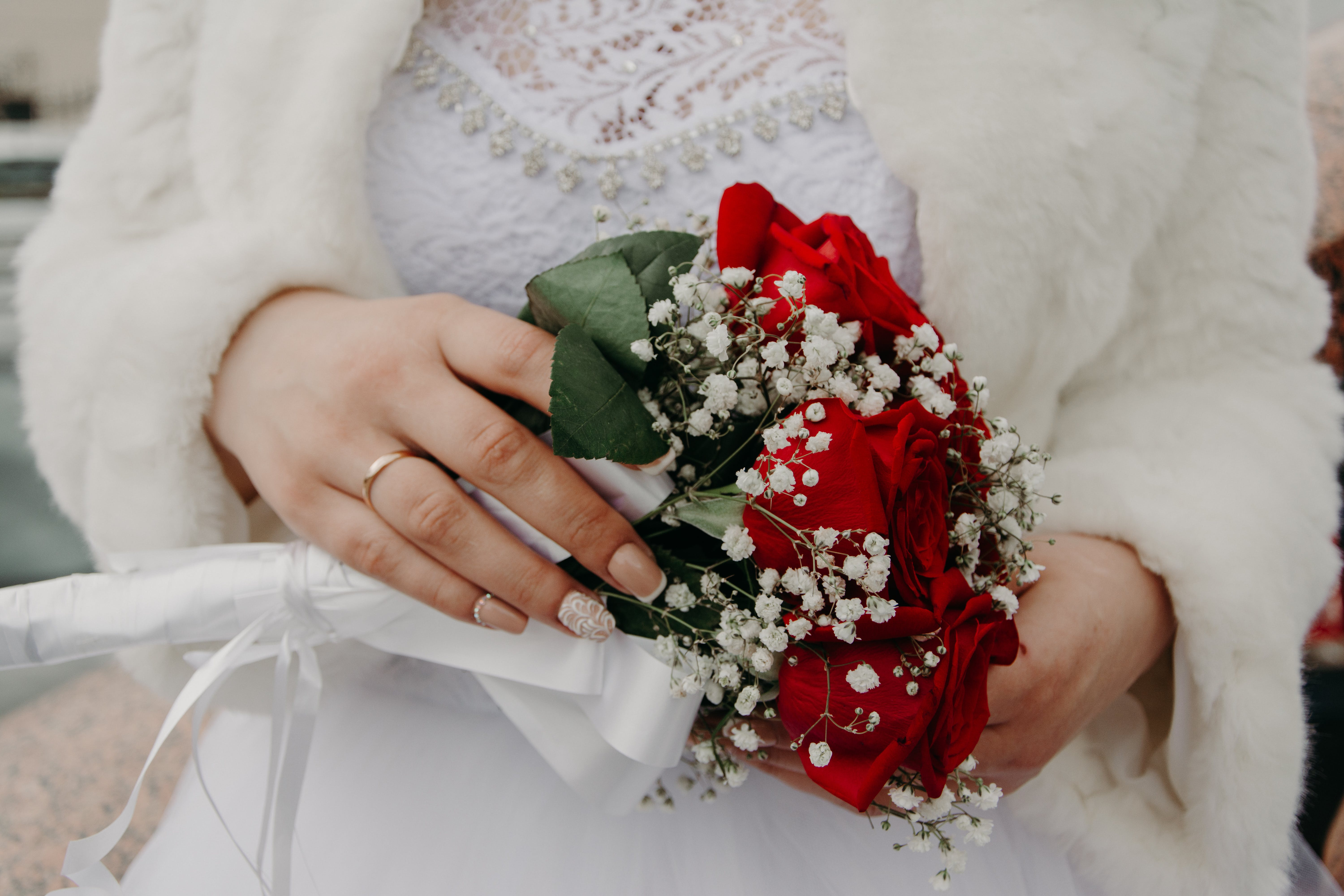 Woman Holding Red Rose Bouquet