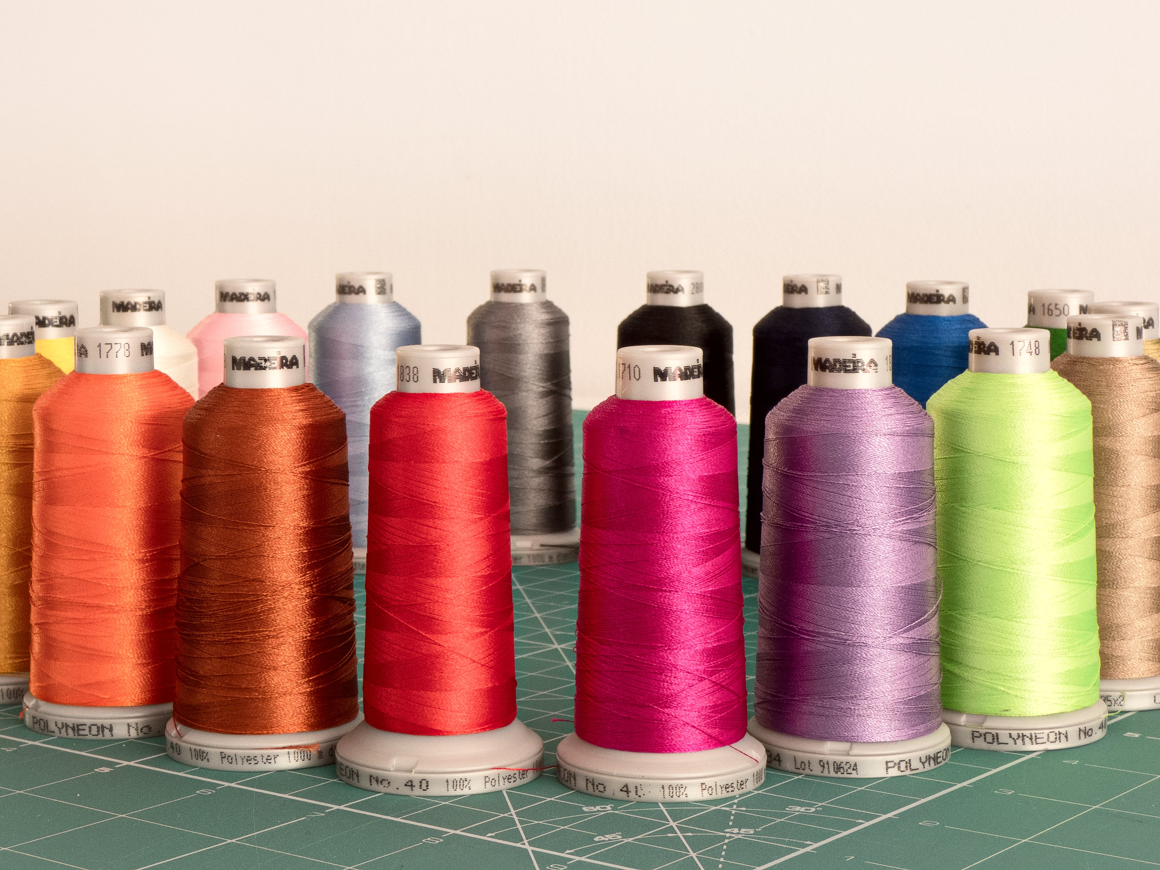 Assorted Sewing Threads on Greensurface