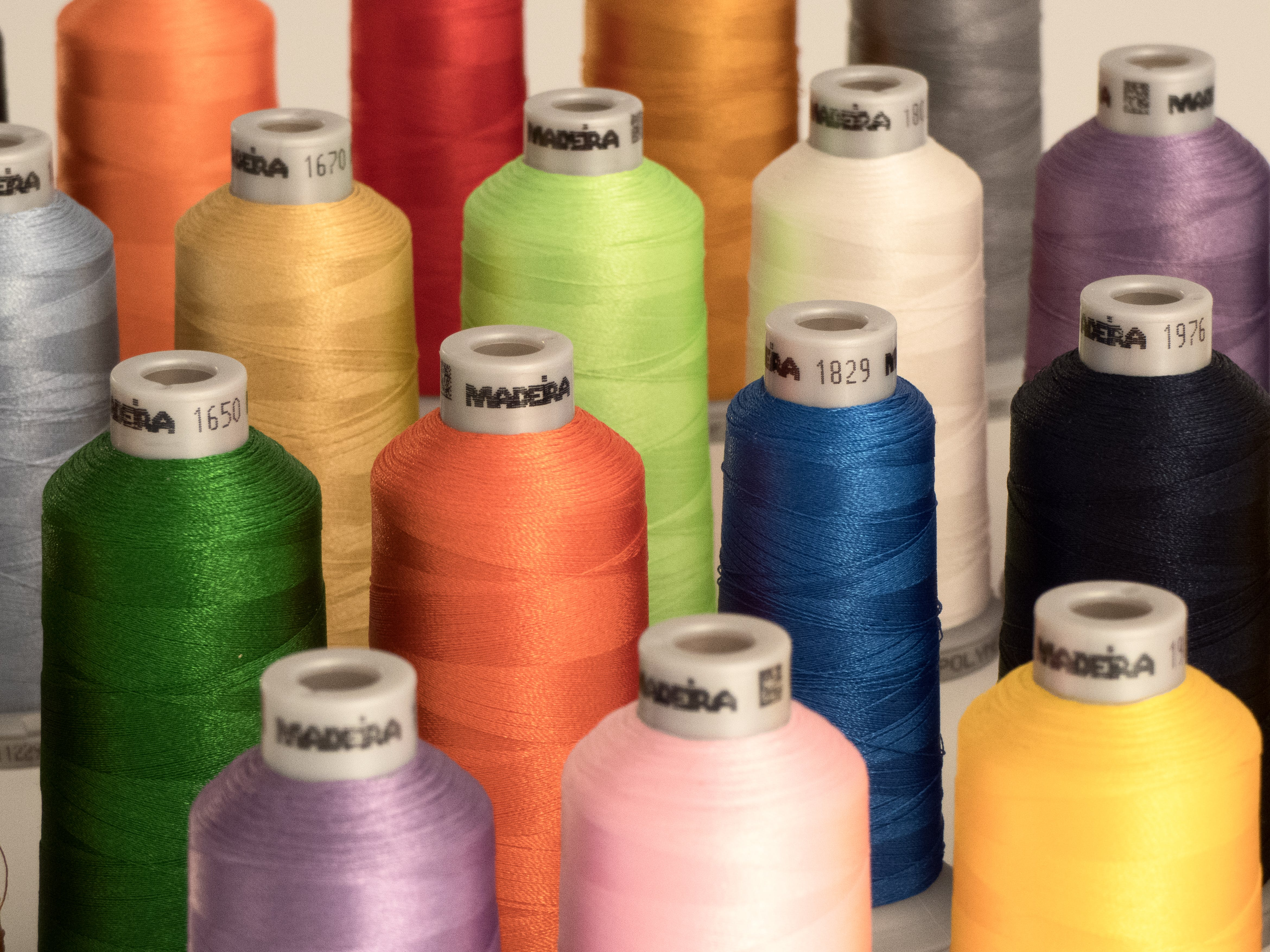 Assorted-color Threads on White Surface