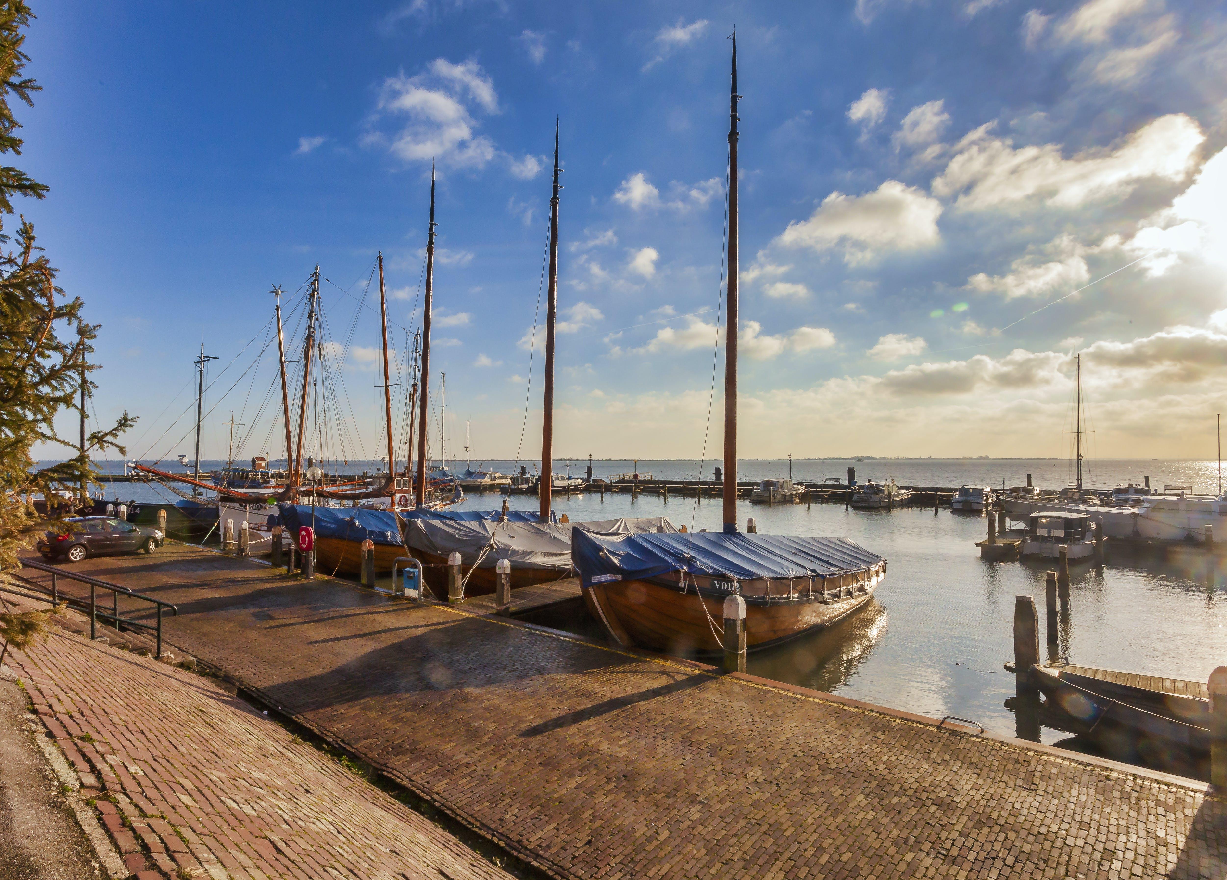 Boats Near Dock Under Gray Sky