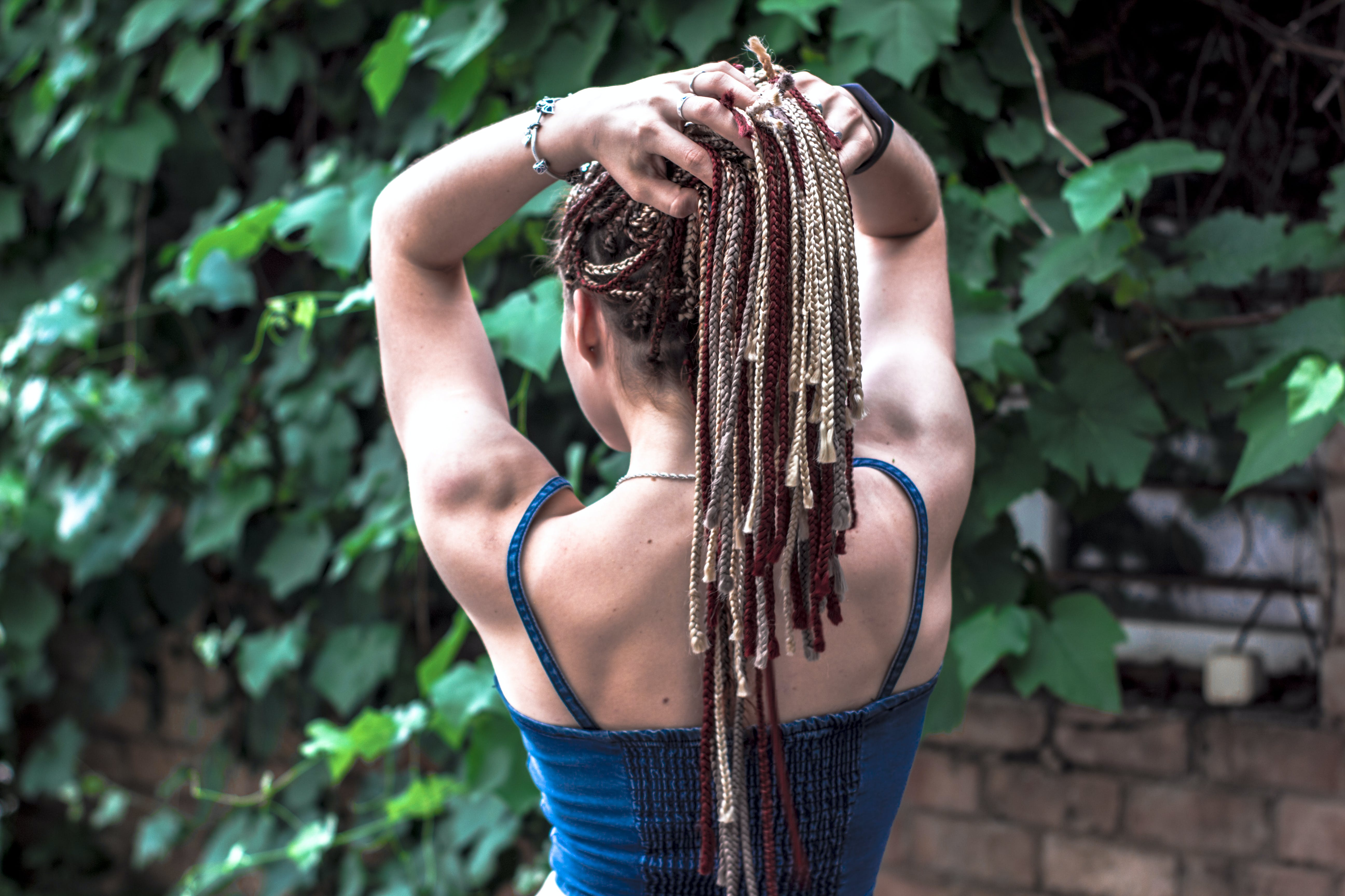 Woman Facing Brown Brick Wall