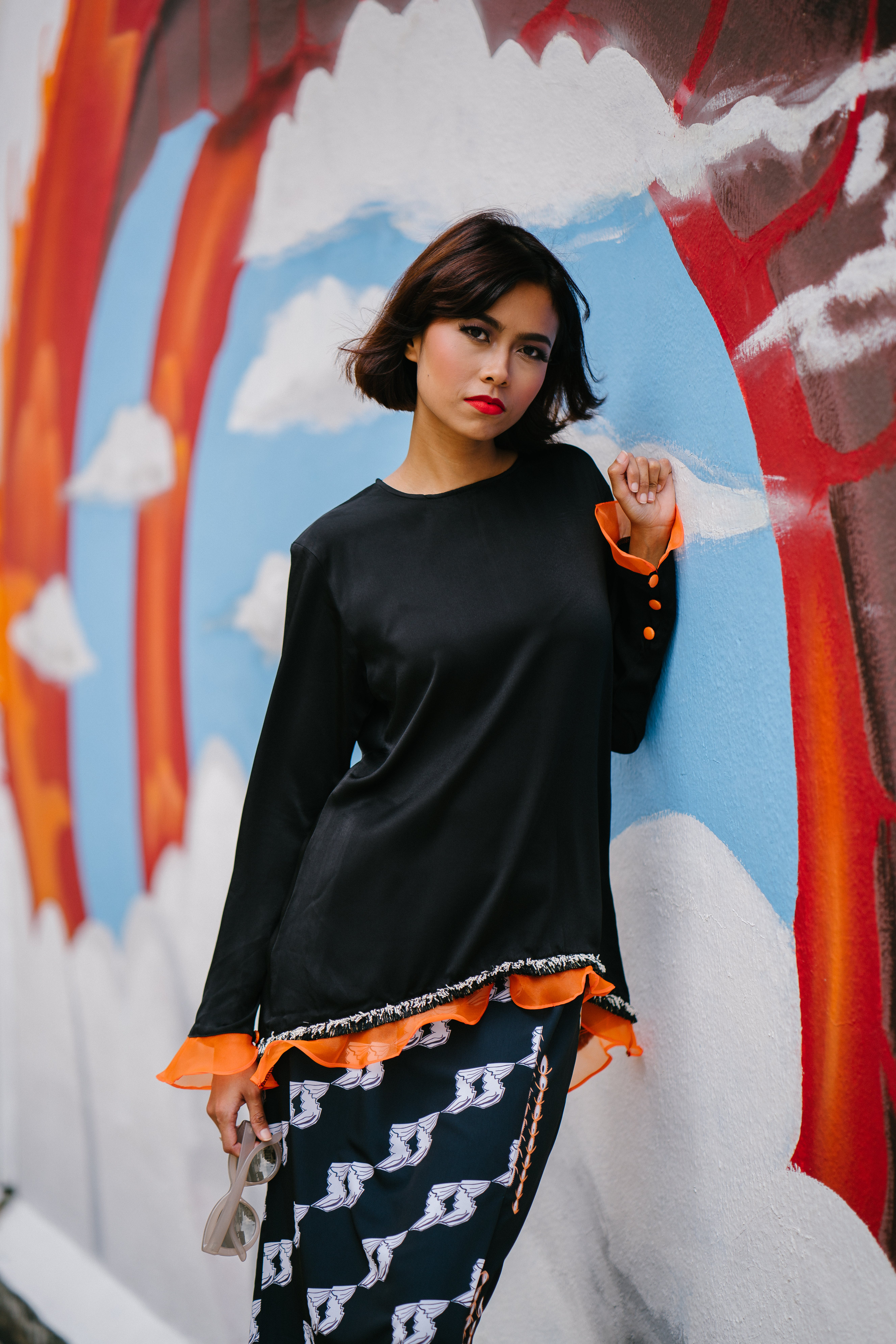 Woman Wearing Black Long-sleeved Shirt Learning on Wall