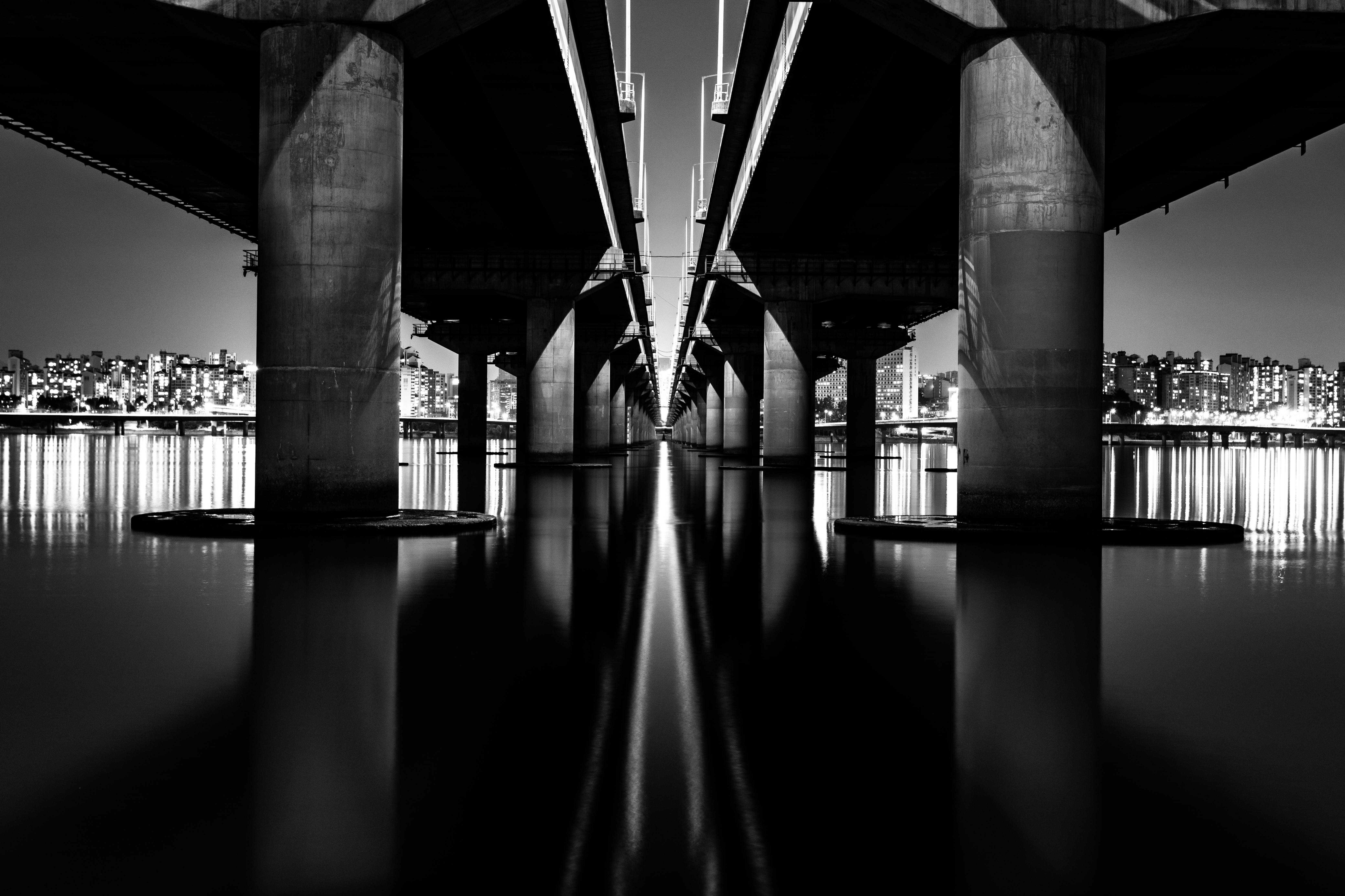 Bridge on Body of Water in Grayscale Photography