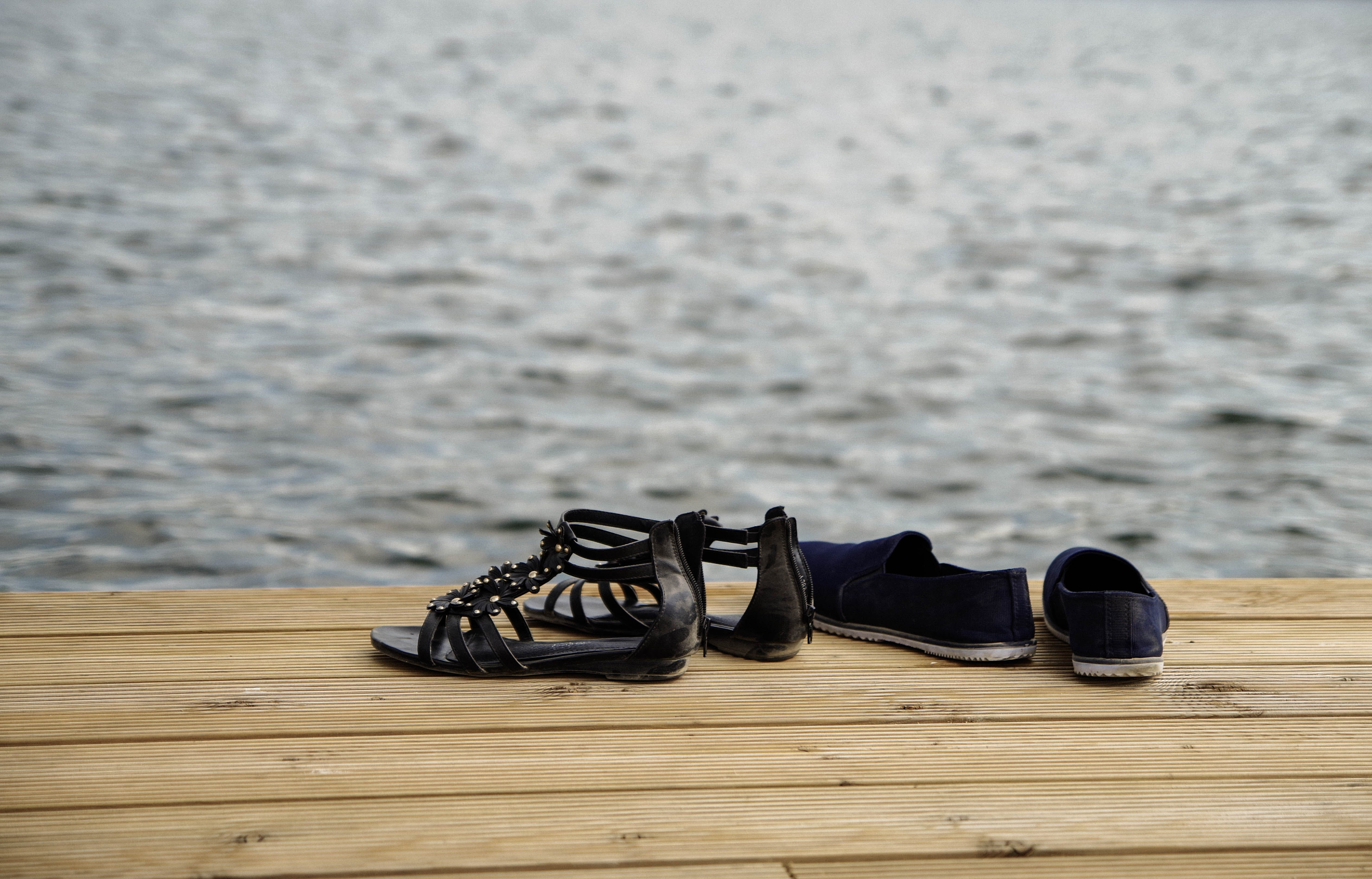 Two Pairs of Sandals on Wood Floor