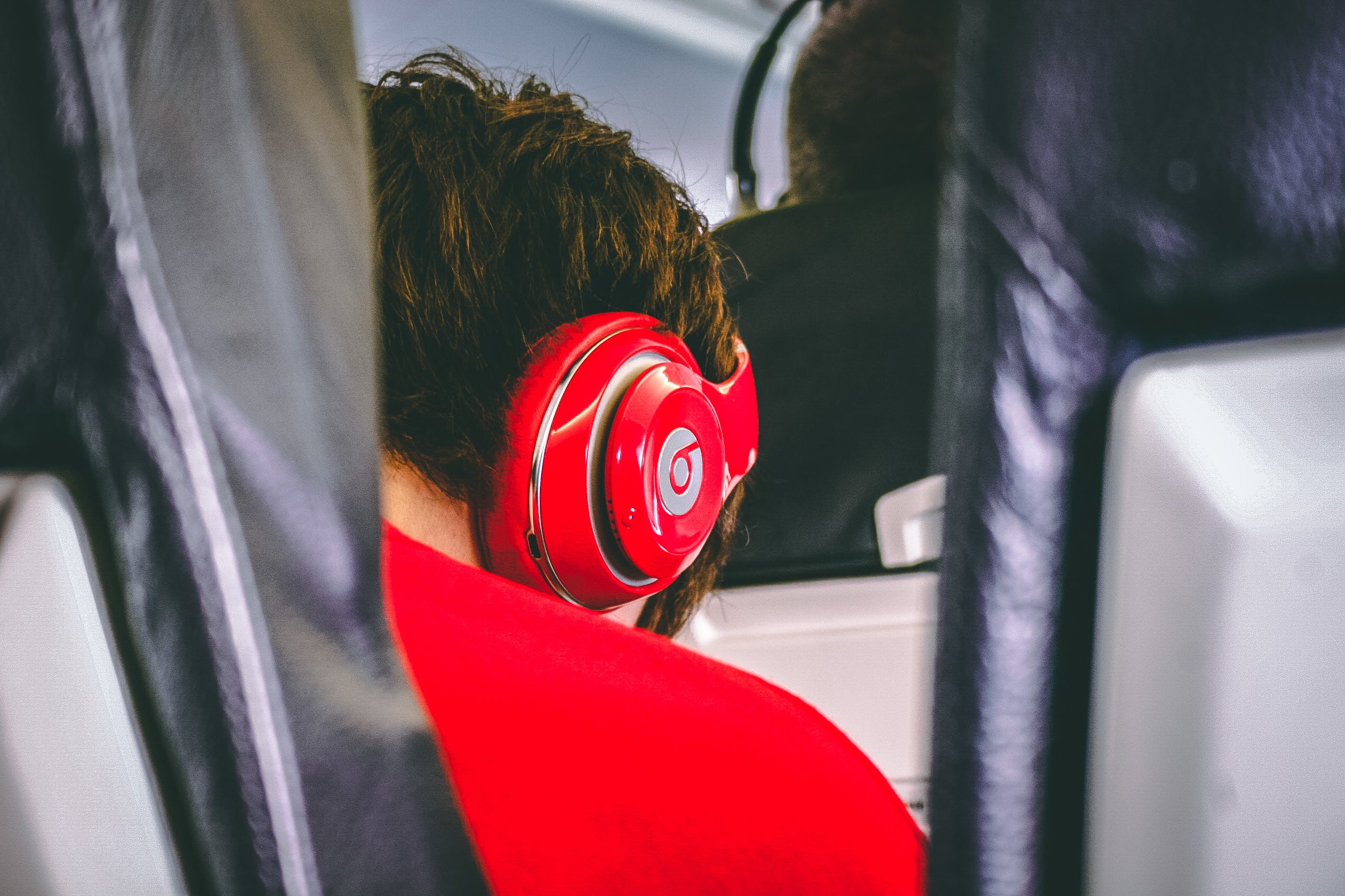 Man Wearing Red Beats By. Dre Headphones