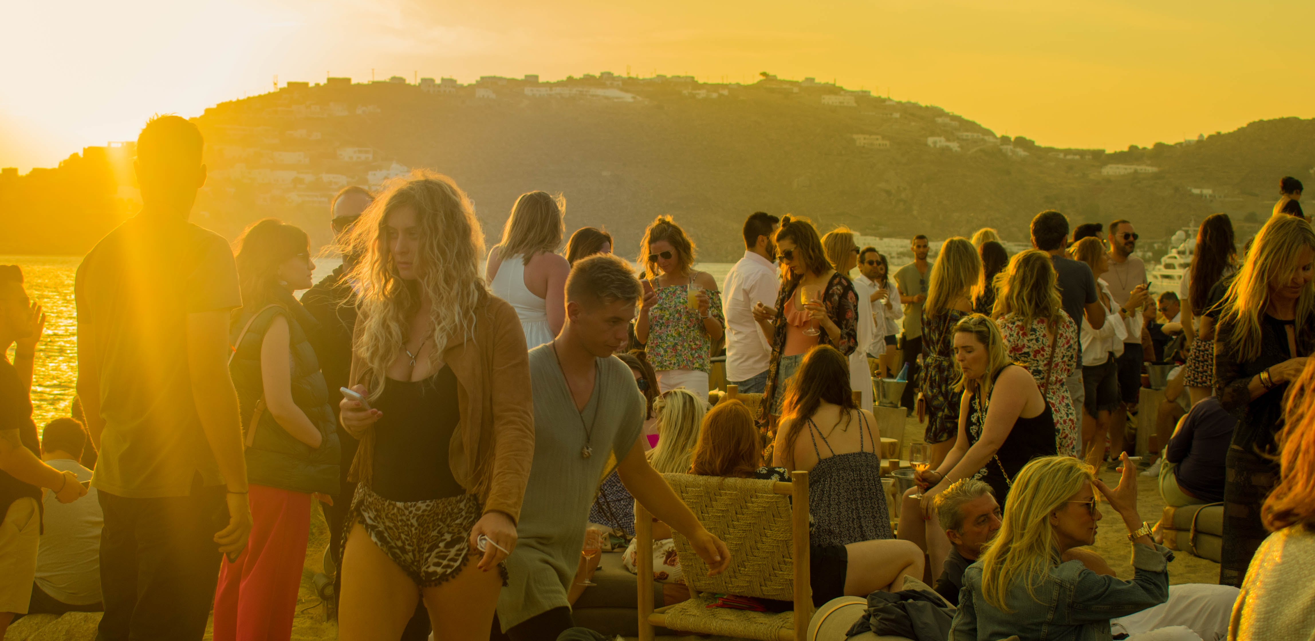 Crowd of People Gathering during Golden Hour