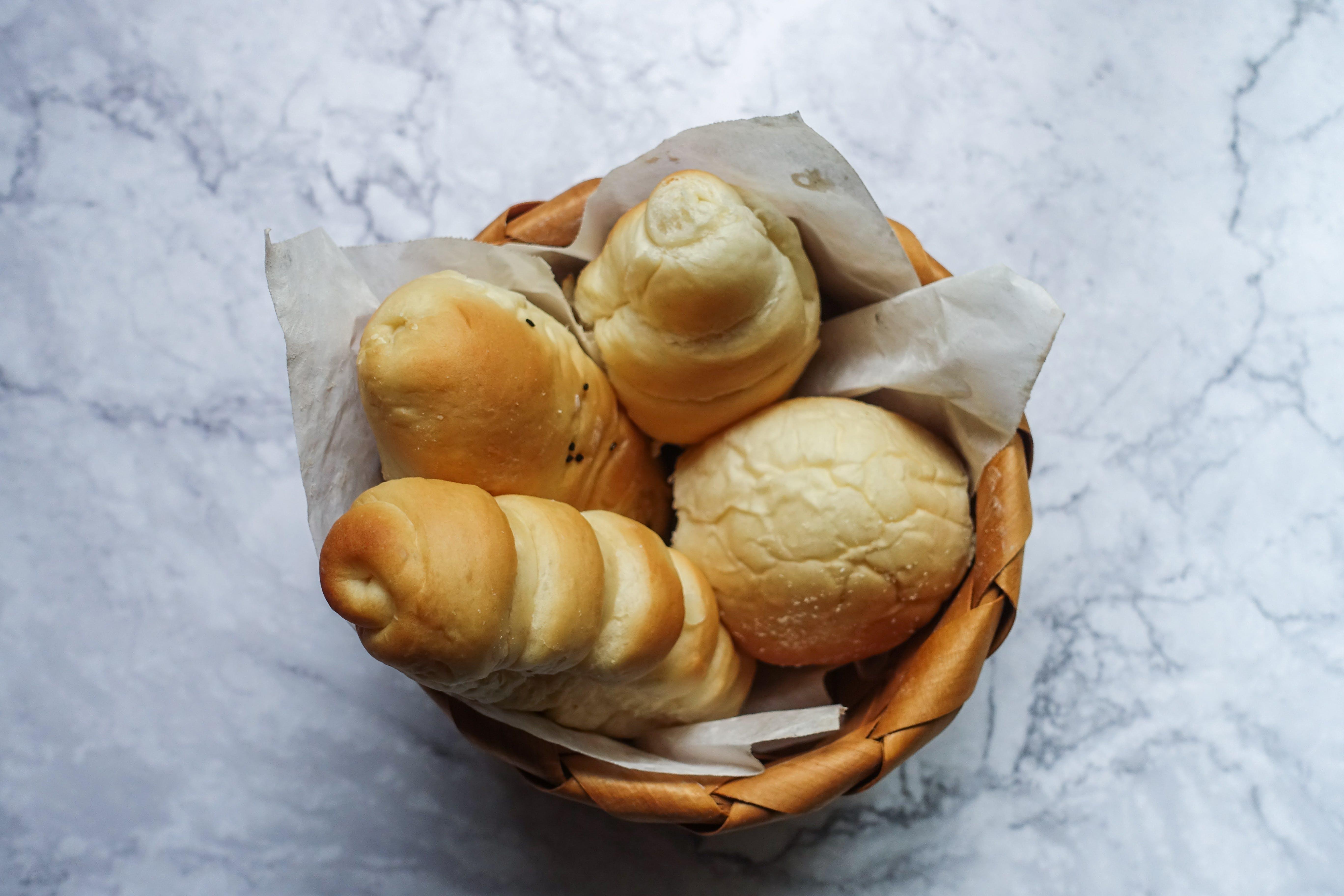 Four Brown Pastries in Brown Wicker Basket