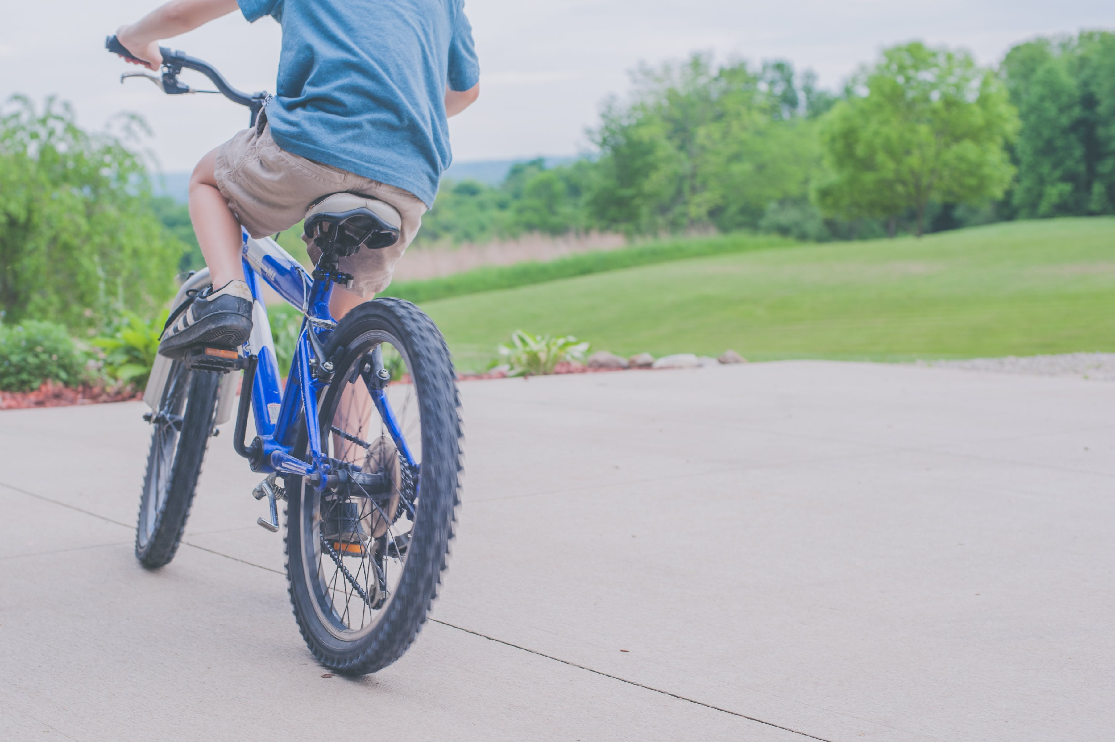 Person Riding Blue Bicycle