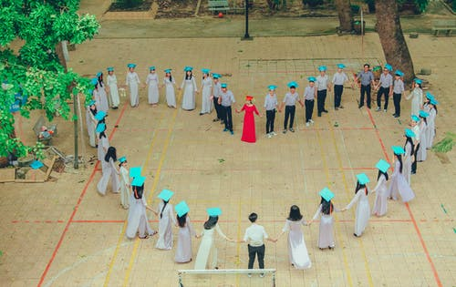Photography of Group of People Form Heart-shape