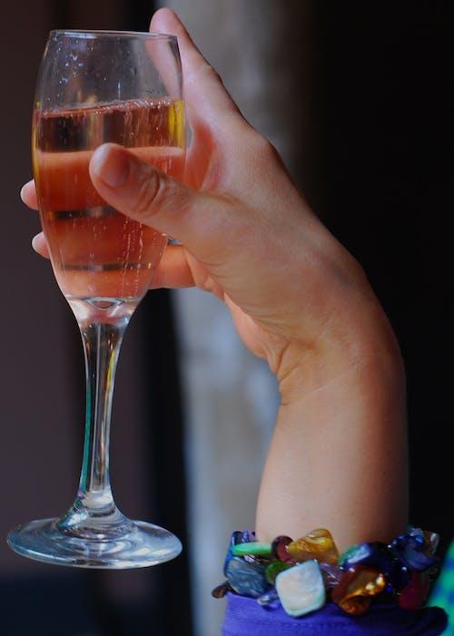 Free stock photo of elegant hand, Pink champagne