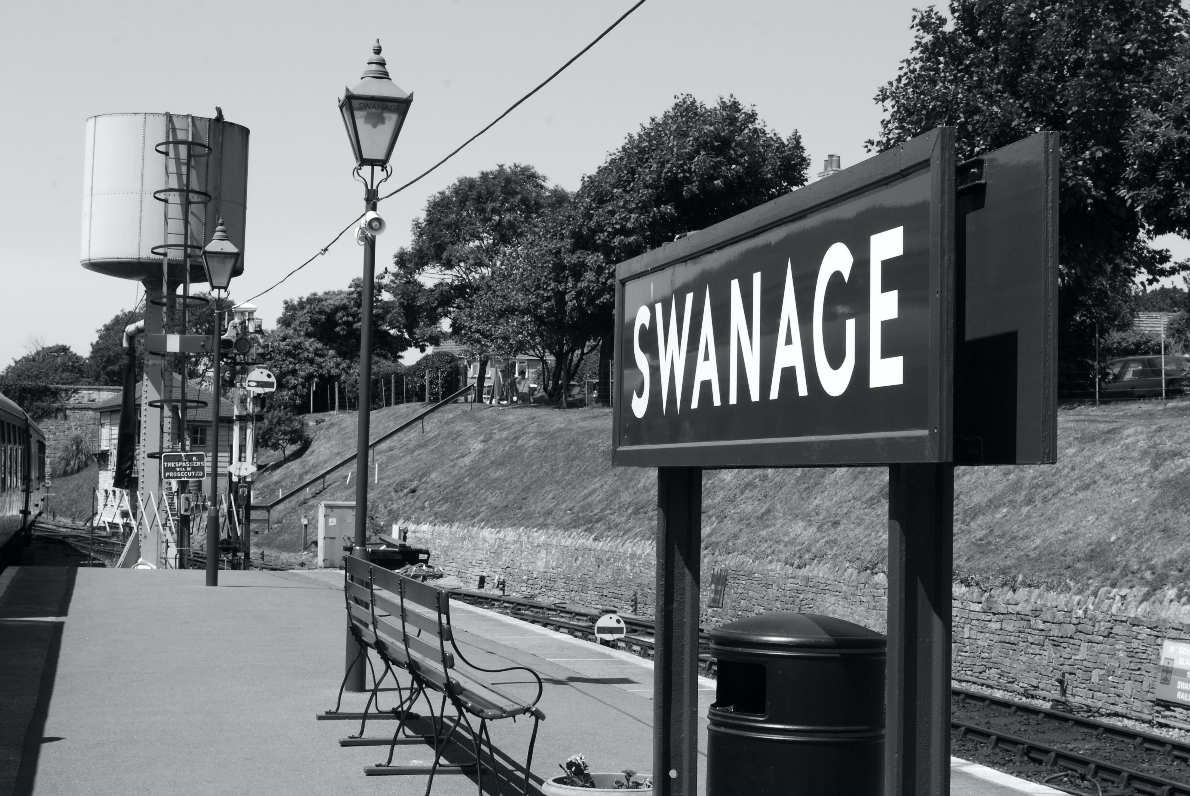 Free stock photo of black and while, swanage, train station