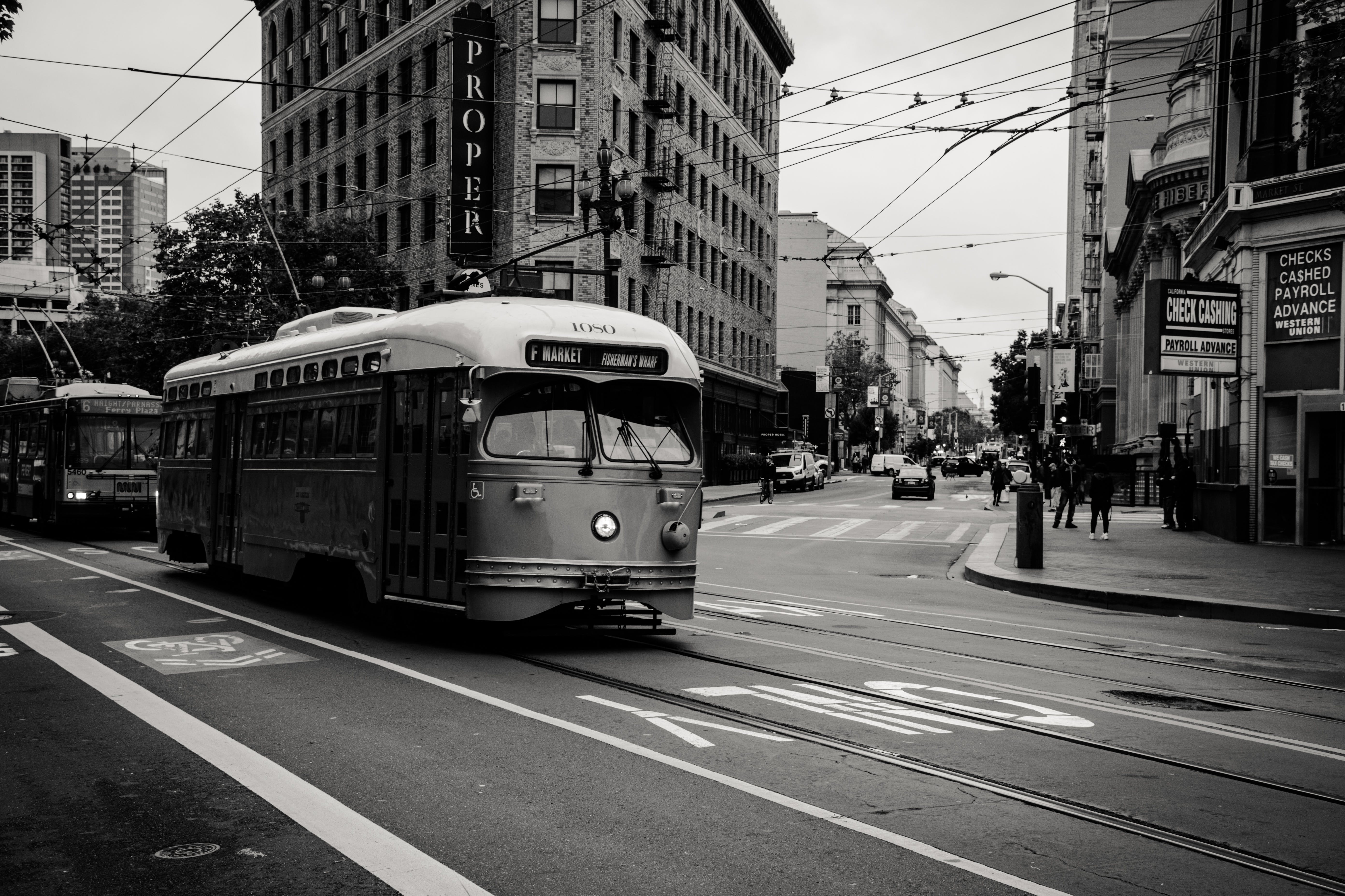 Grayscale Photography of Tram Near Buildings