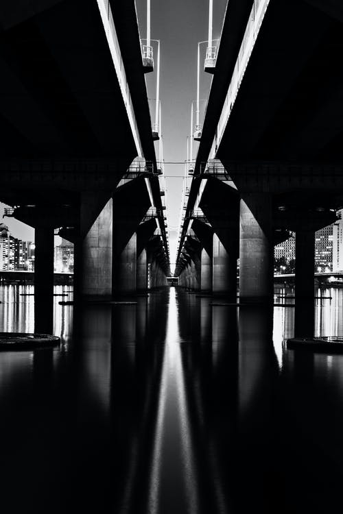 Greyscale Photography of Bridge