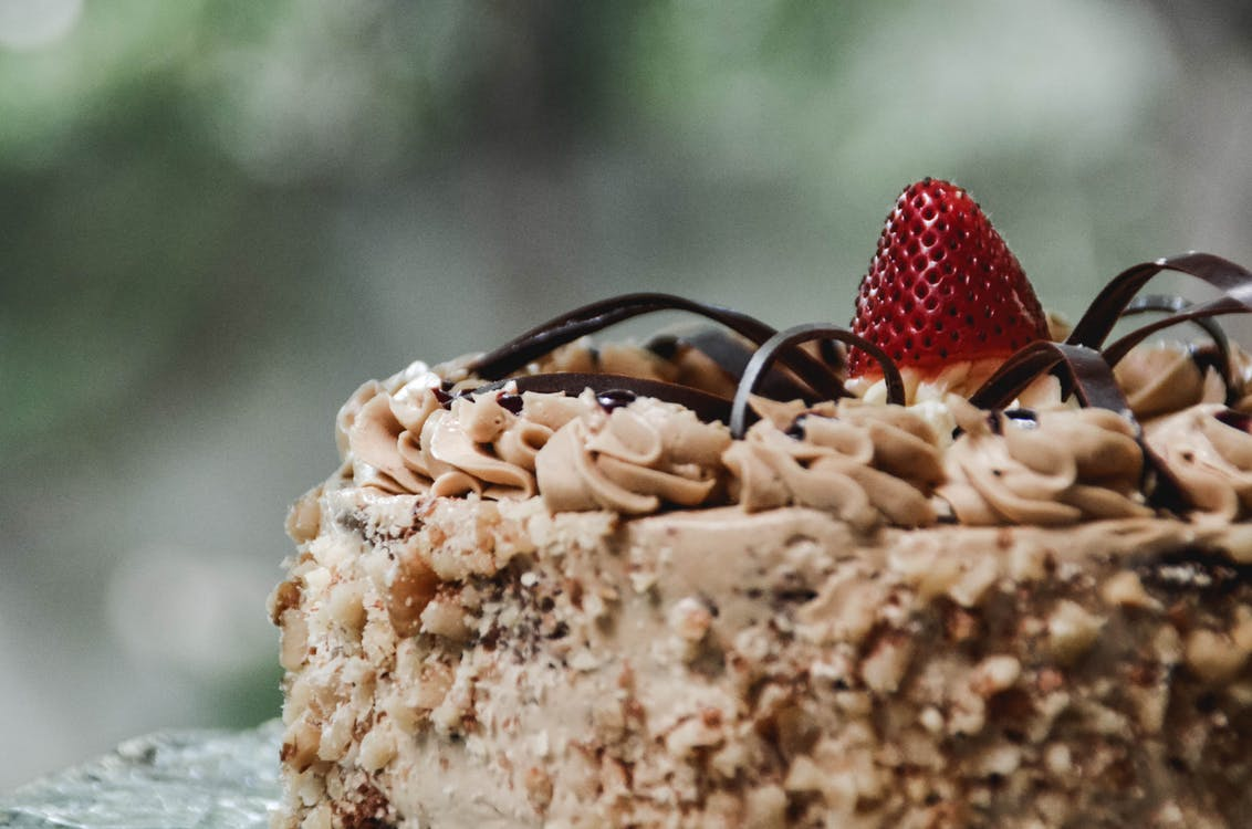 Shallow Focus Photography of Cake with Strawberry on Top