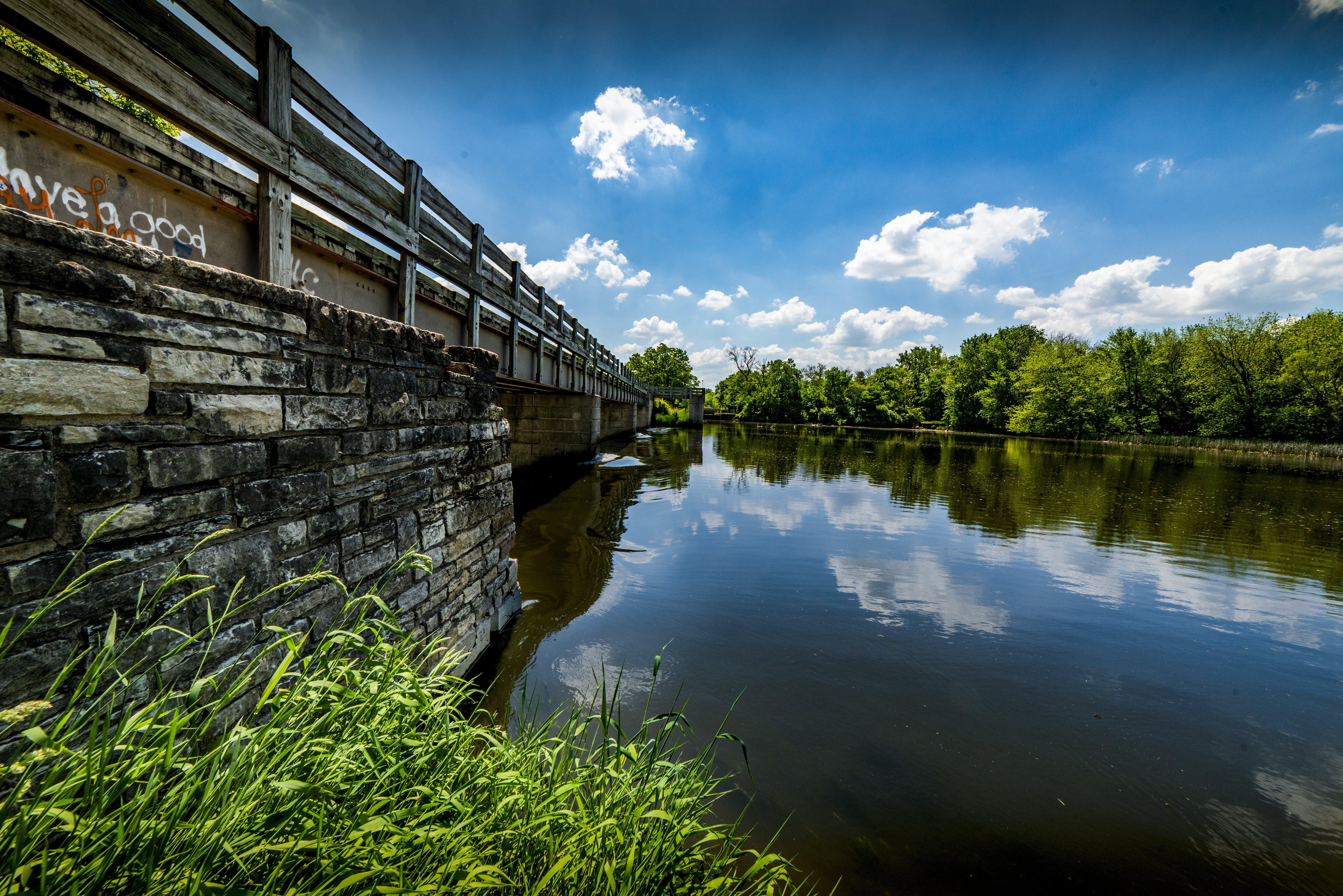 Gray Steel Bridge Near Body of Water