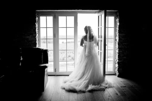 Grayscaled Photography of Woman Wearing Wedding Dress