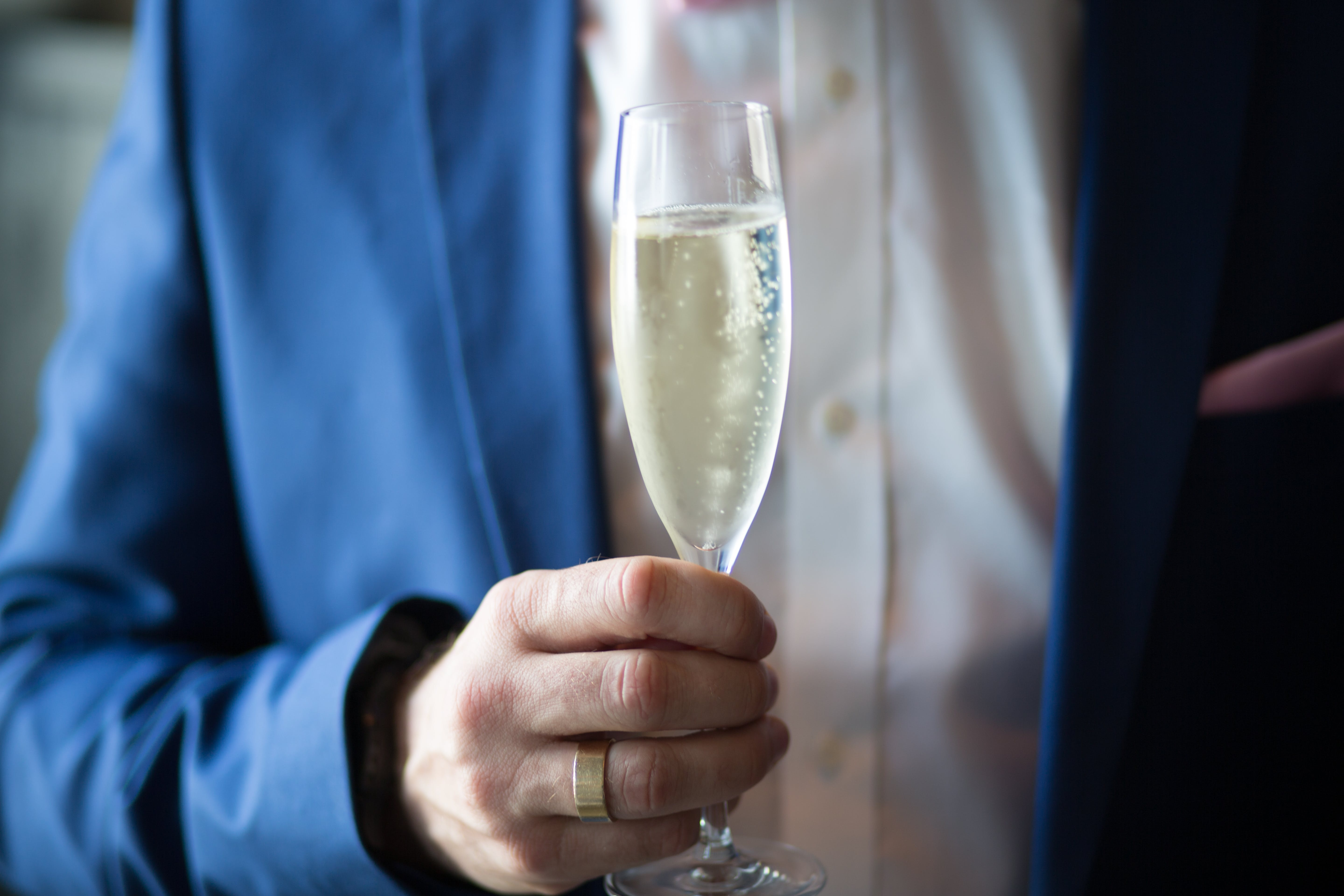 Man Holding Filled Champagne