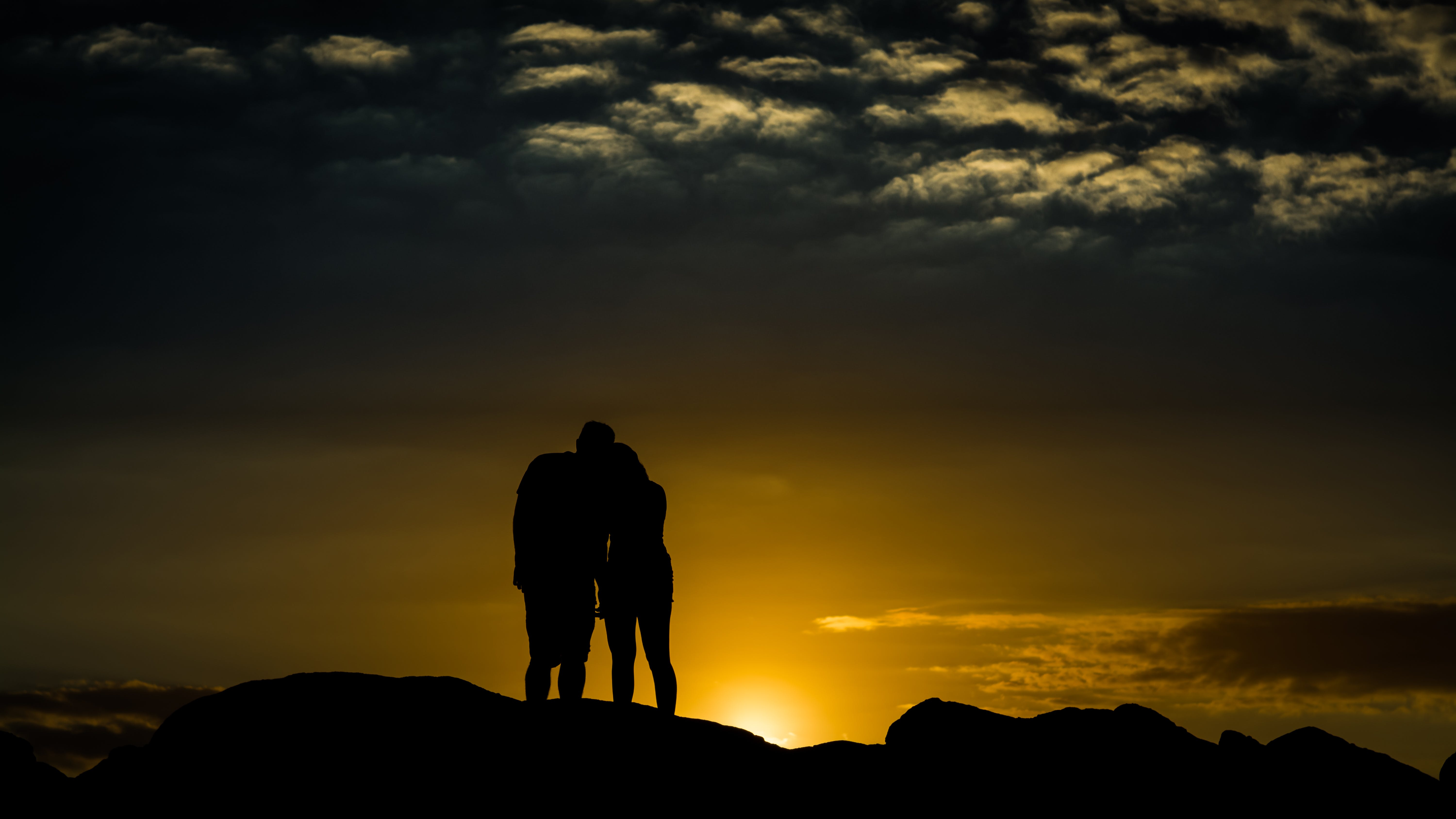 Silhouette Photo of Man and Woman
