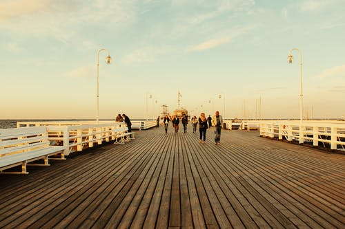 People Walking on Board Walk