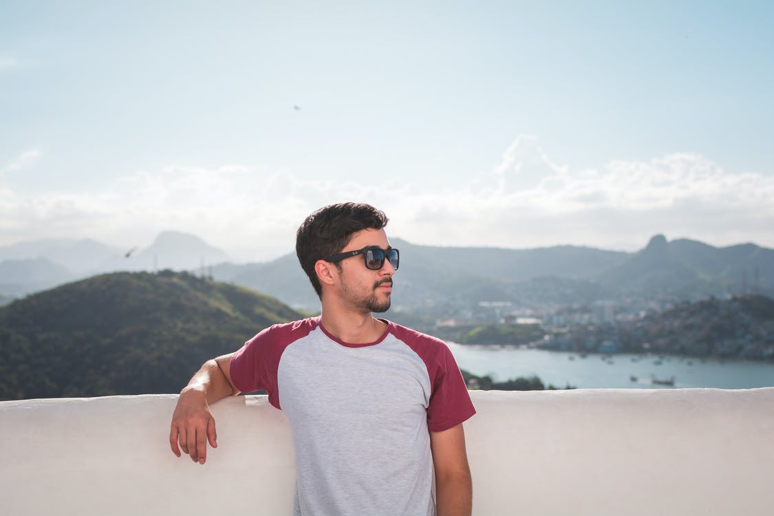 Man in White and Red Crew-neck T-shirt in Shallow Focus Photography