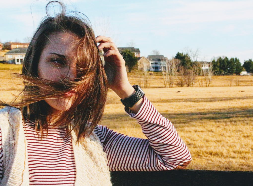 Woman About to Hold Her Hair during Daytiome