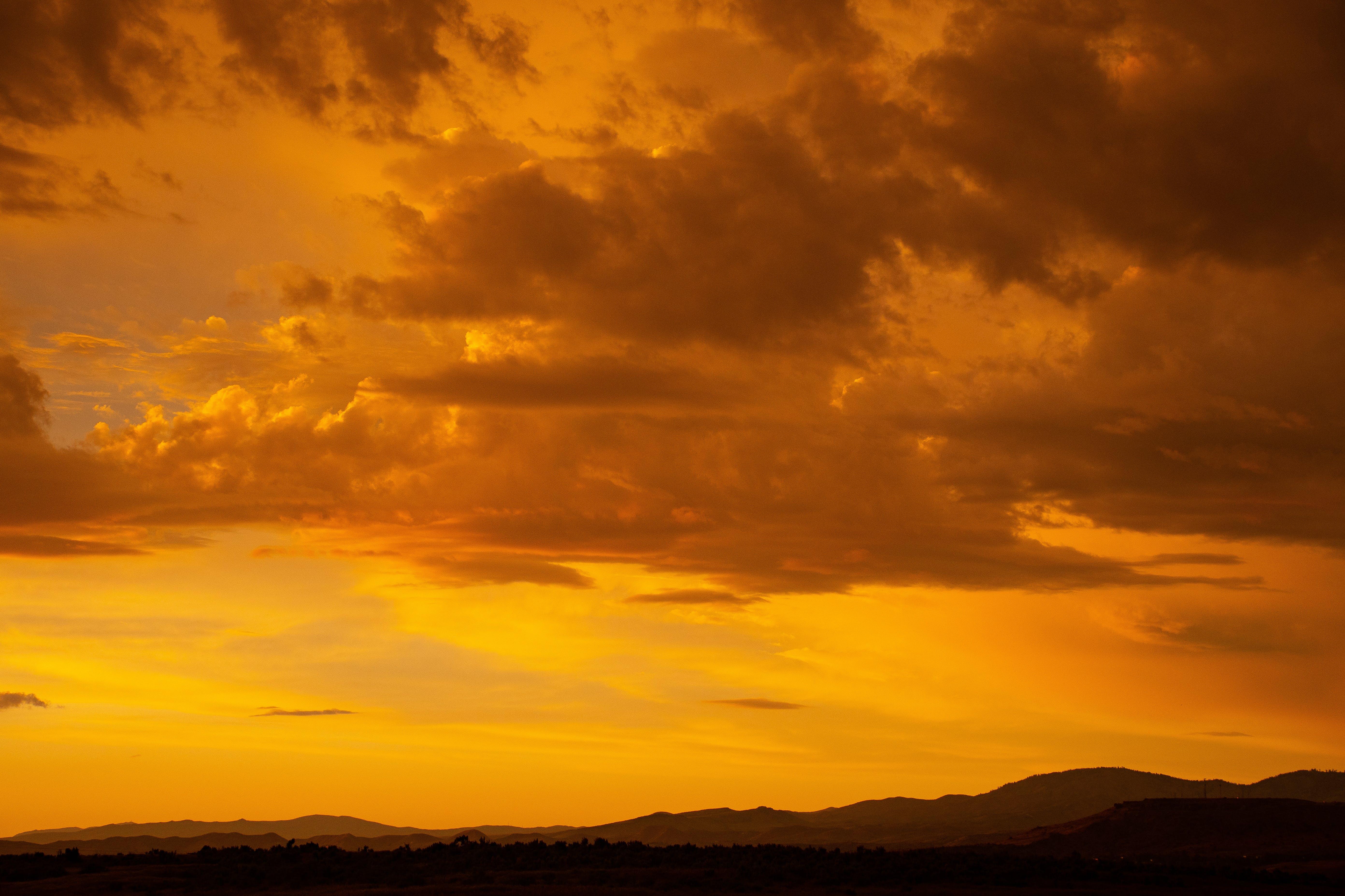 Sunset Under Cloudy Sky