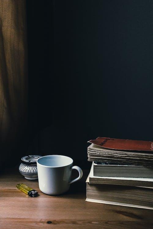 White Ceramic Mug and Yellow Disposable Lighter