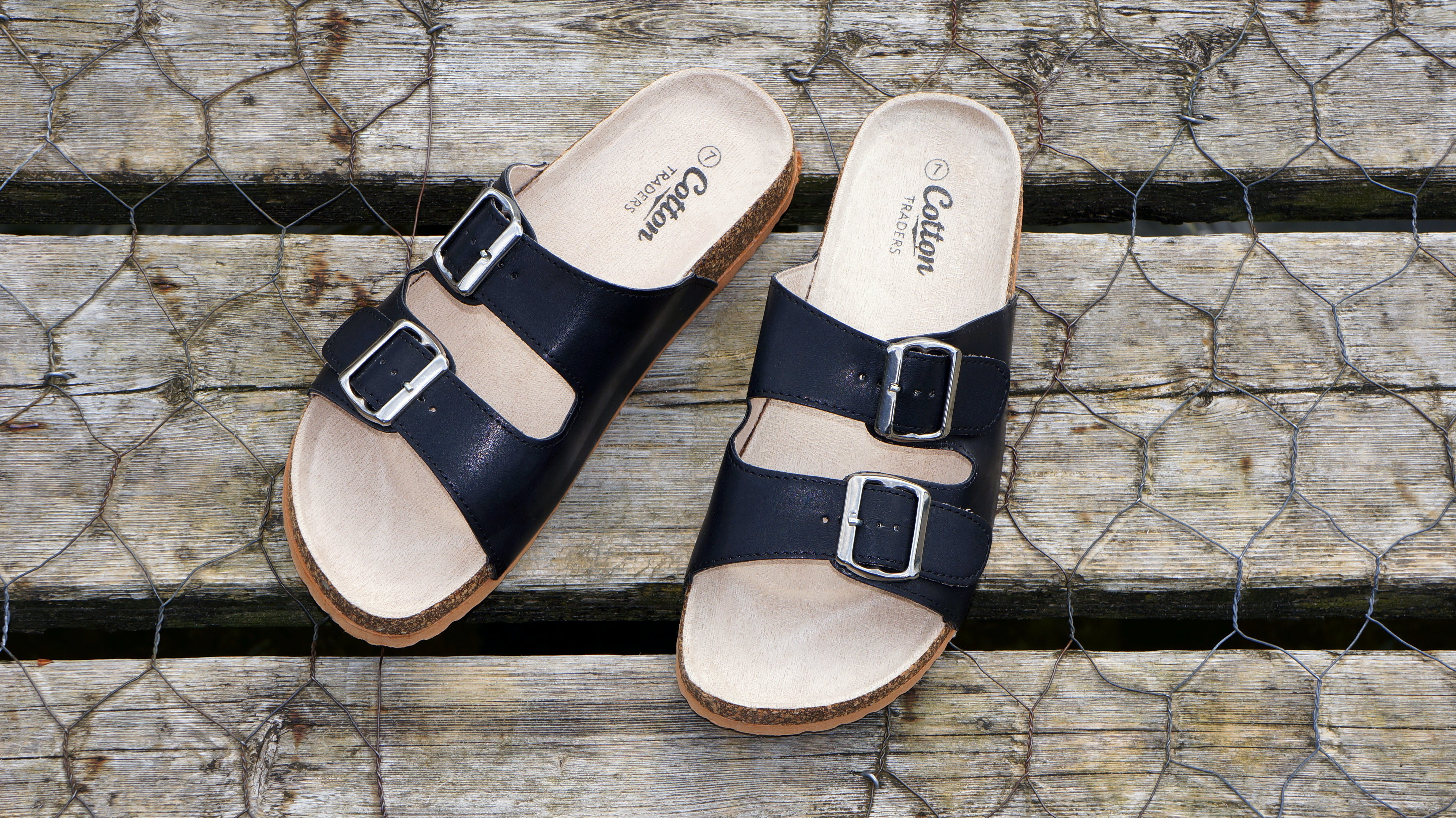 Brown-and-black Cotton Leather Sandals on Gray Metal Screen