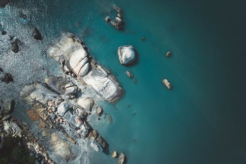 Body of Water With Rocks