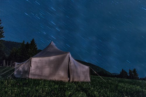 Brown Tent on Green Grass during Night Time