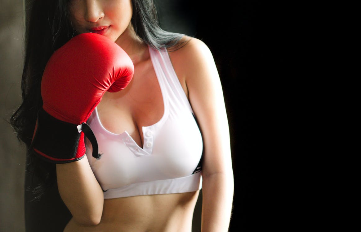 Woman in White Sports Bra and Red Boxing Glove