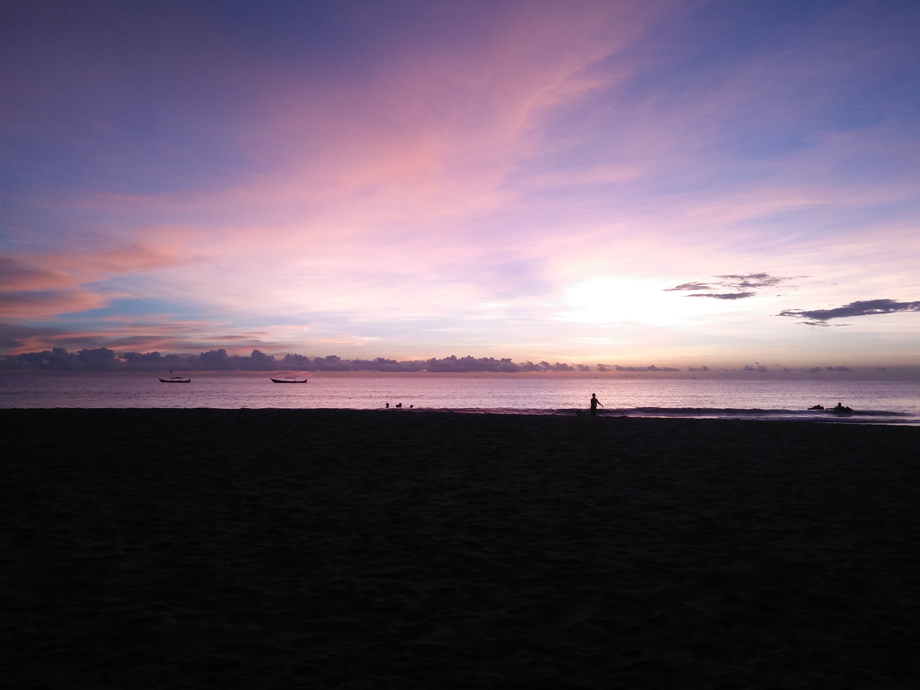 Silhouette Photography of People on Seashore